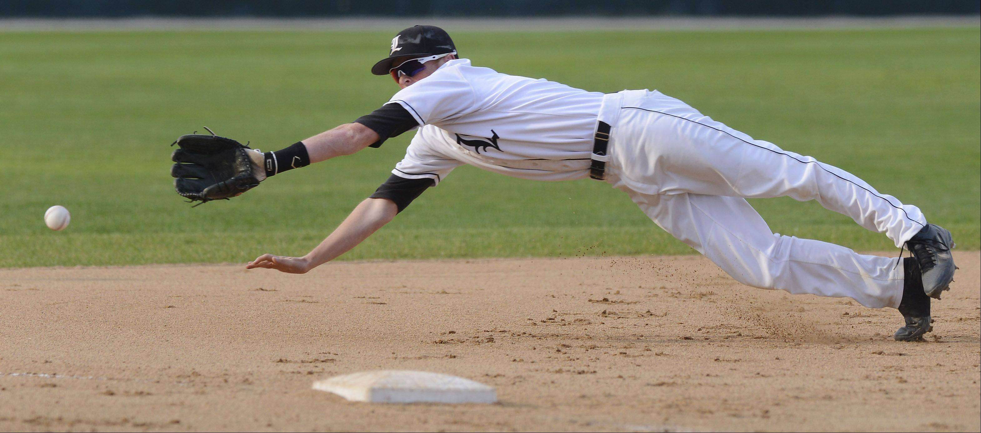 Libertyville third baseman P.J. Neumann dives for a ball that went for a Mt. Carmel double in the fourth inning of the Class 4A state baseball championship game at Silver Cross Field in Joliet Saturday.