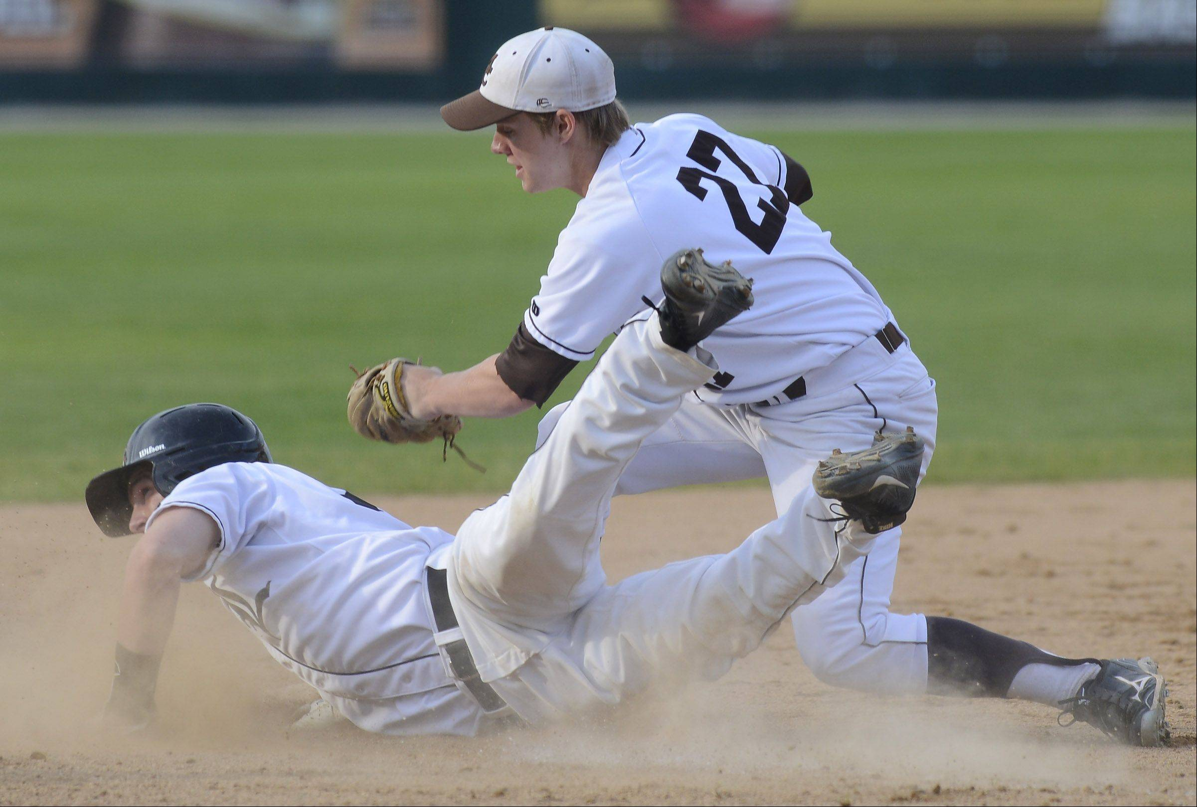 Libertyville's Connor Simpson gets tagged out by Mt. Carmel third baseman Beau Filkins after wandering too far off the bag on a missed squeeze attempt in the fourth inning of the Class 4A state baseball championship game at Silver Cross Field in Joliet Saturday.