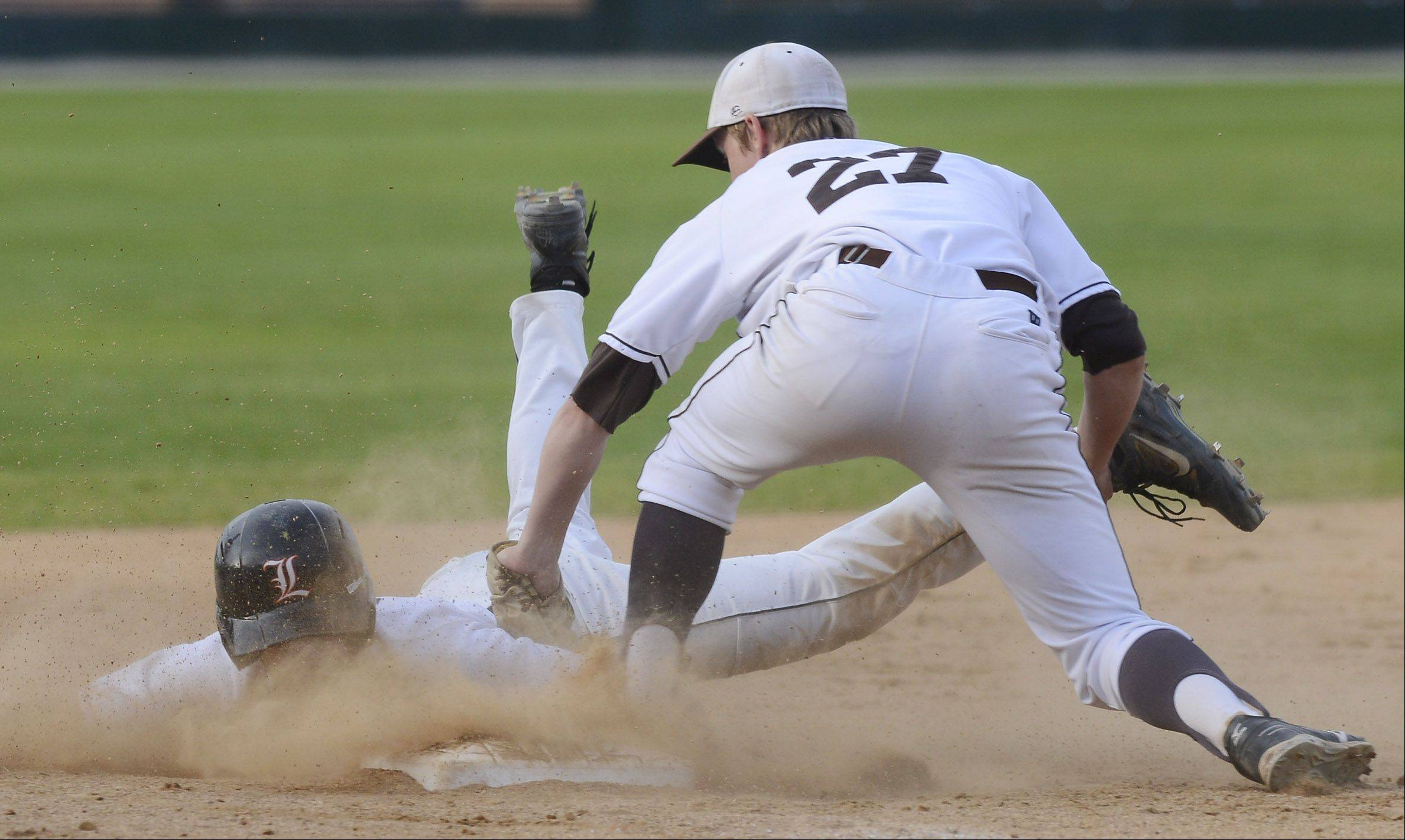 Libertyville's Justin Guarnaccio gets tagged out by Mt. Carmel third baseman Beau Filkins while trying to advance on an infield ground ball during the fifth inning of the Class 4A state baseball championship game at Silver Cross Field in Joliet Saturday.