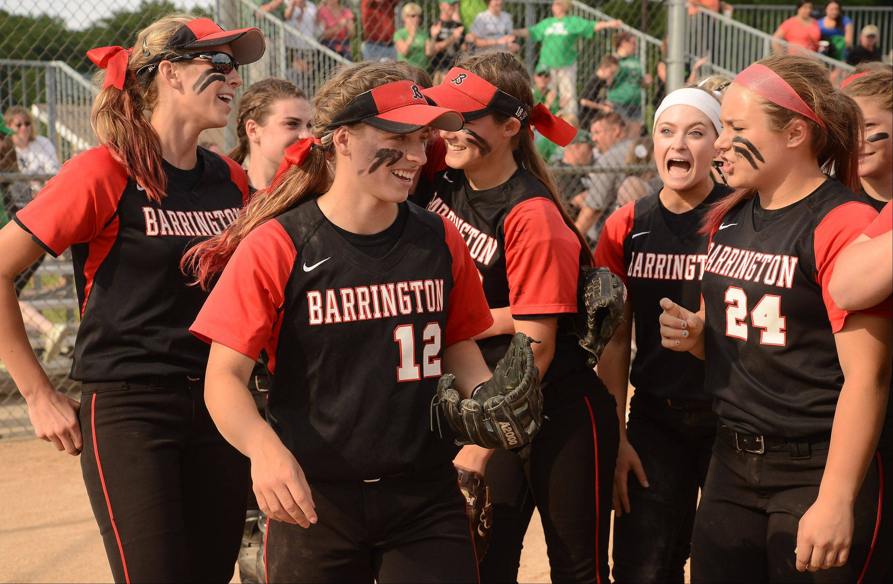 Barrington celebrates its Class 4A softball third-place finish after defeating York 5-1.