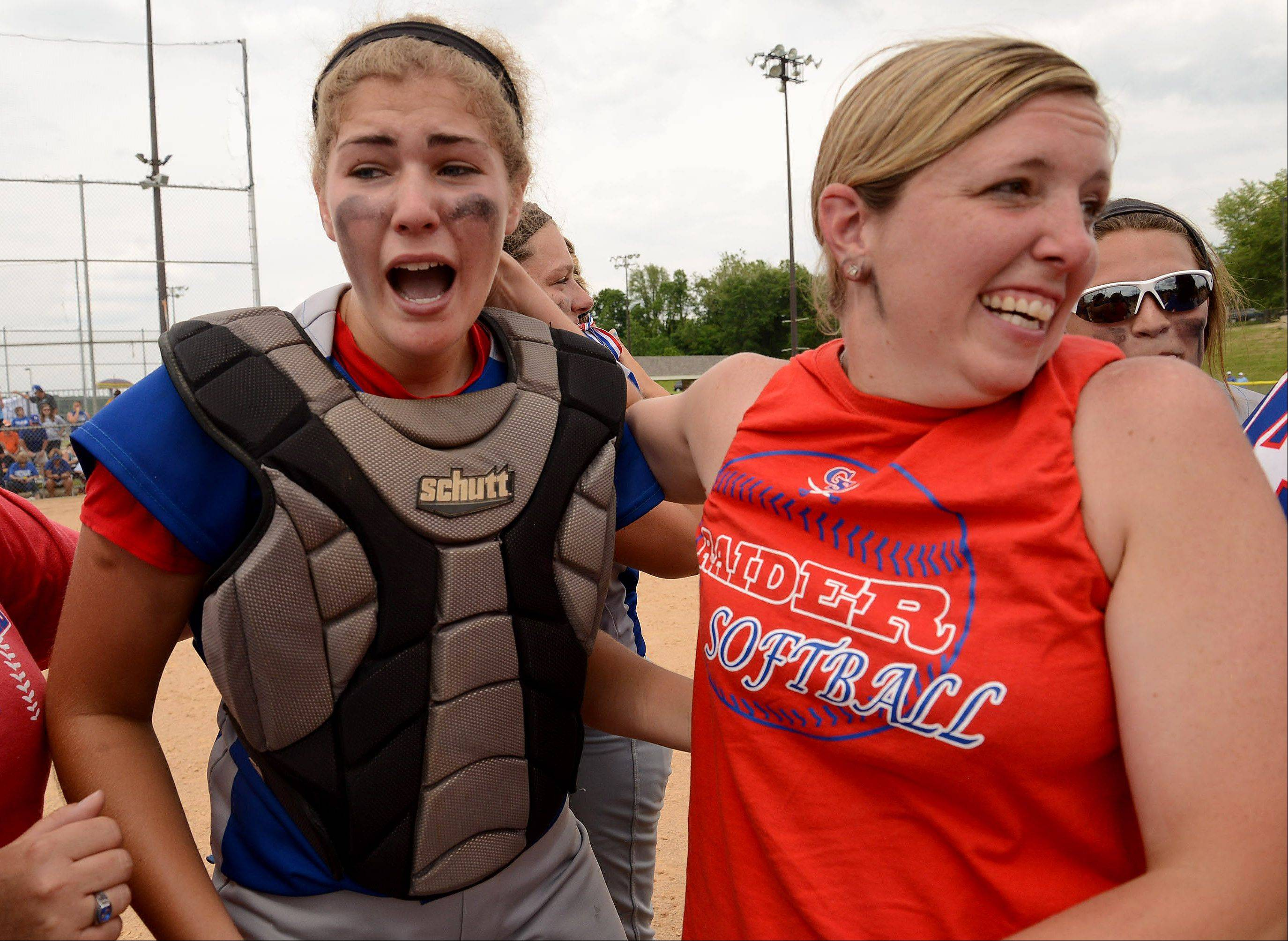 Glenbard South's catcher Jane Trzaska and head coach Julie Fonda celebrate their victory Saturday over Alton Marquette, which brought the team its second consecutive Class 3A state championship.