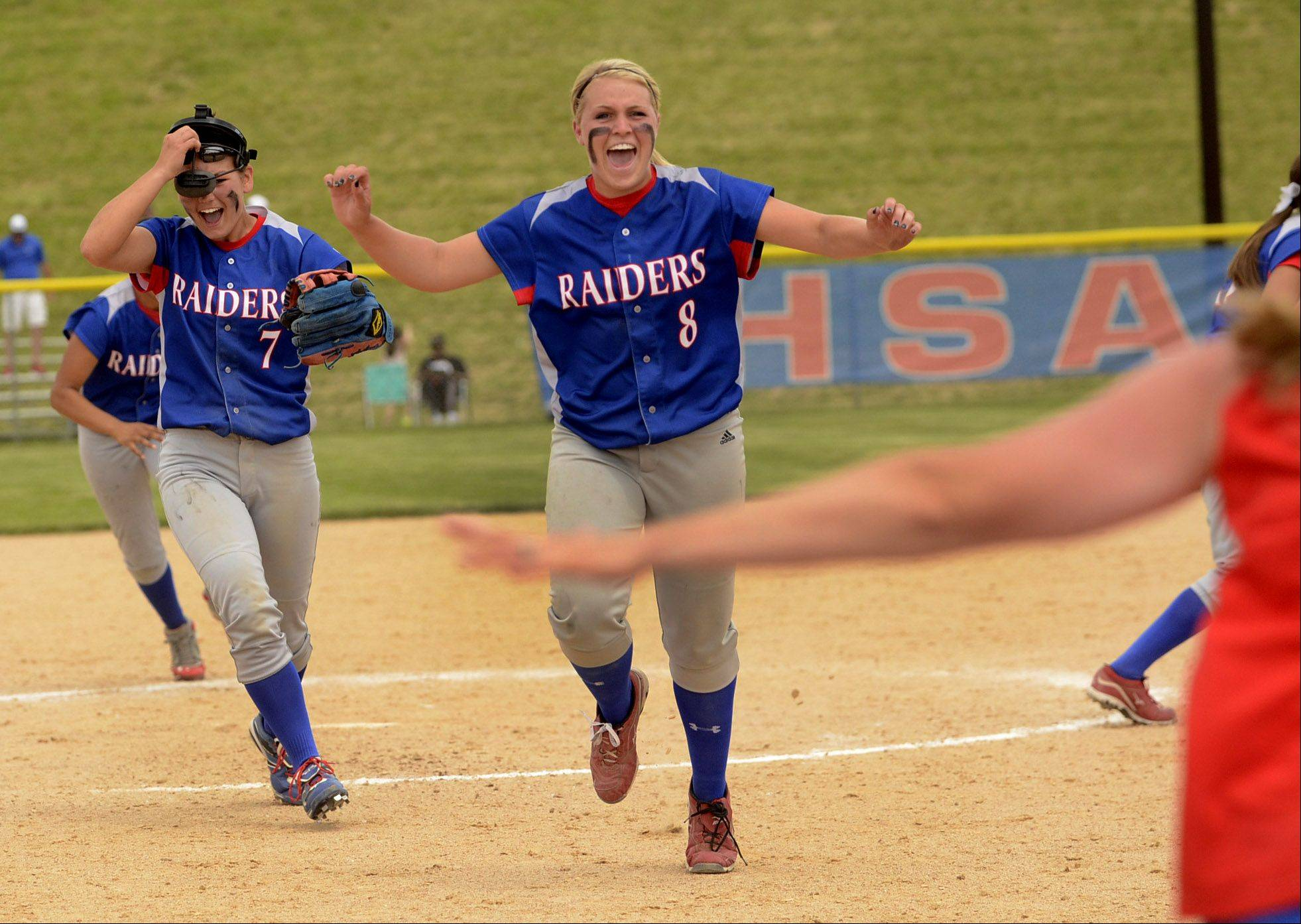 Third baseman Hannah Taylor, left, and pitcher Stephanie Chitkowski jump for joy after the final out of the game, as Glenbard South repeats as Class 3A state champions after defeating Alton Marquette.