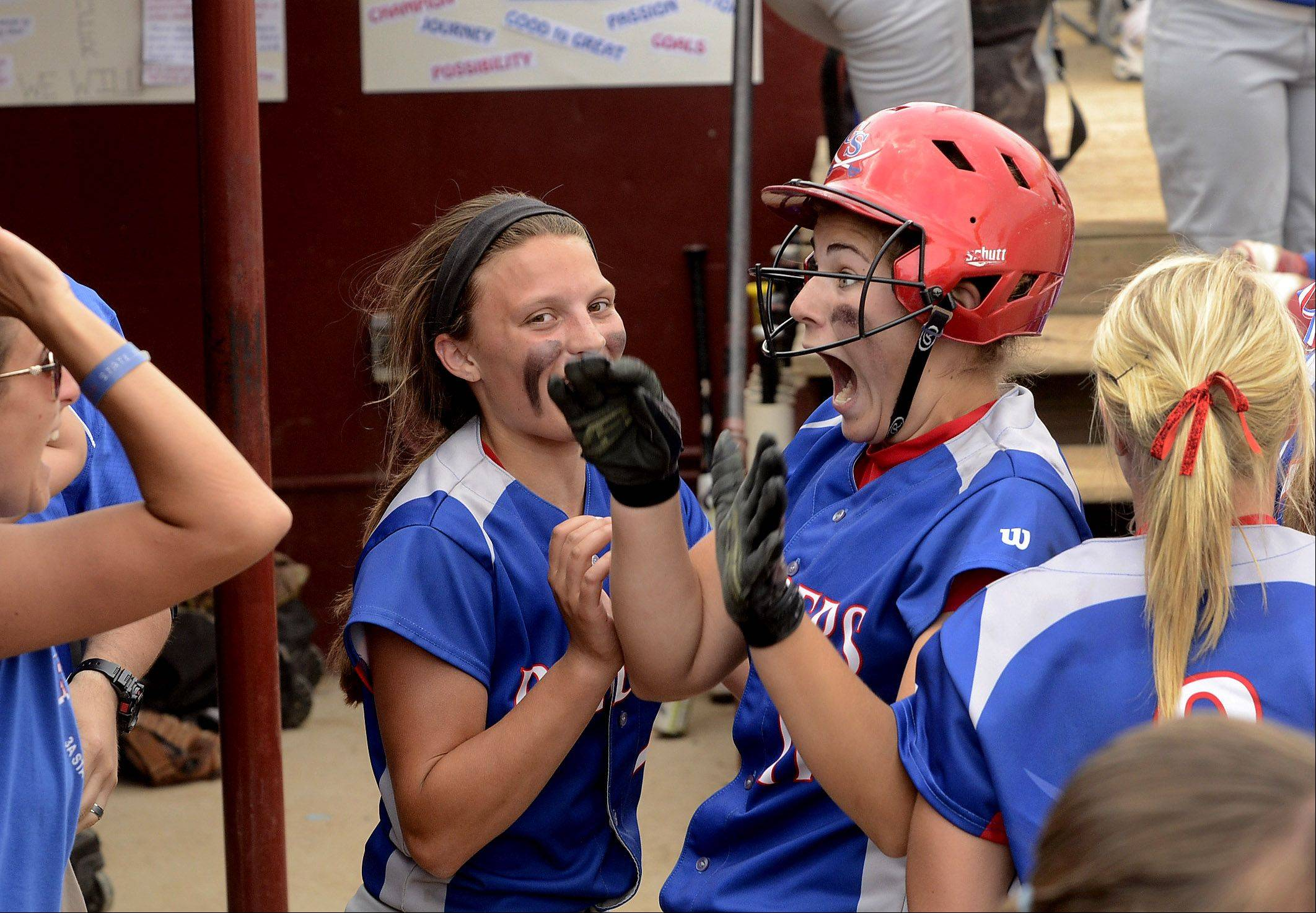 Glenbard South's Jane Trzaska celebrates with teammates in the dugout after singling to right in the top of the eighth inning for the eventual game-winning hit in the Class 3A state championship game between Glenbard South and Alton Marquette.