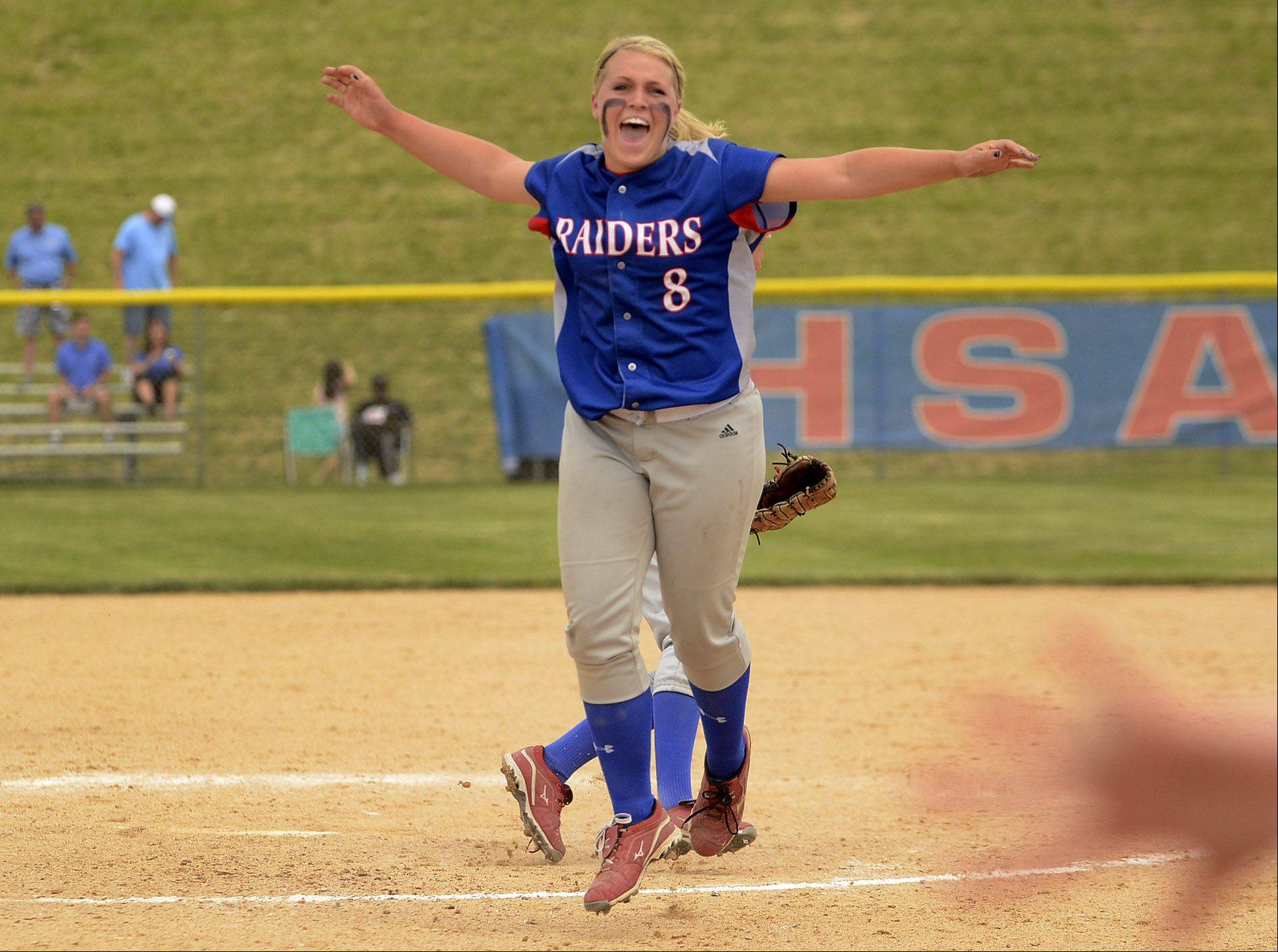 Pitcher Stephanie Chitkowski jumps for joy after the final out of the game as Glenbard South repeats as Class 3A softball state champions.