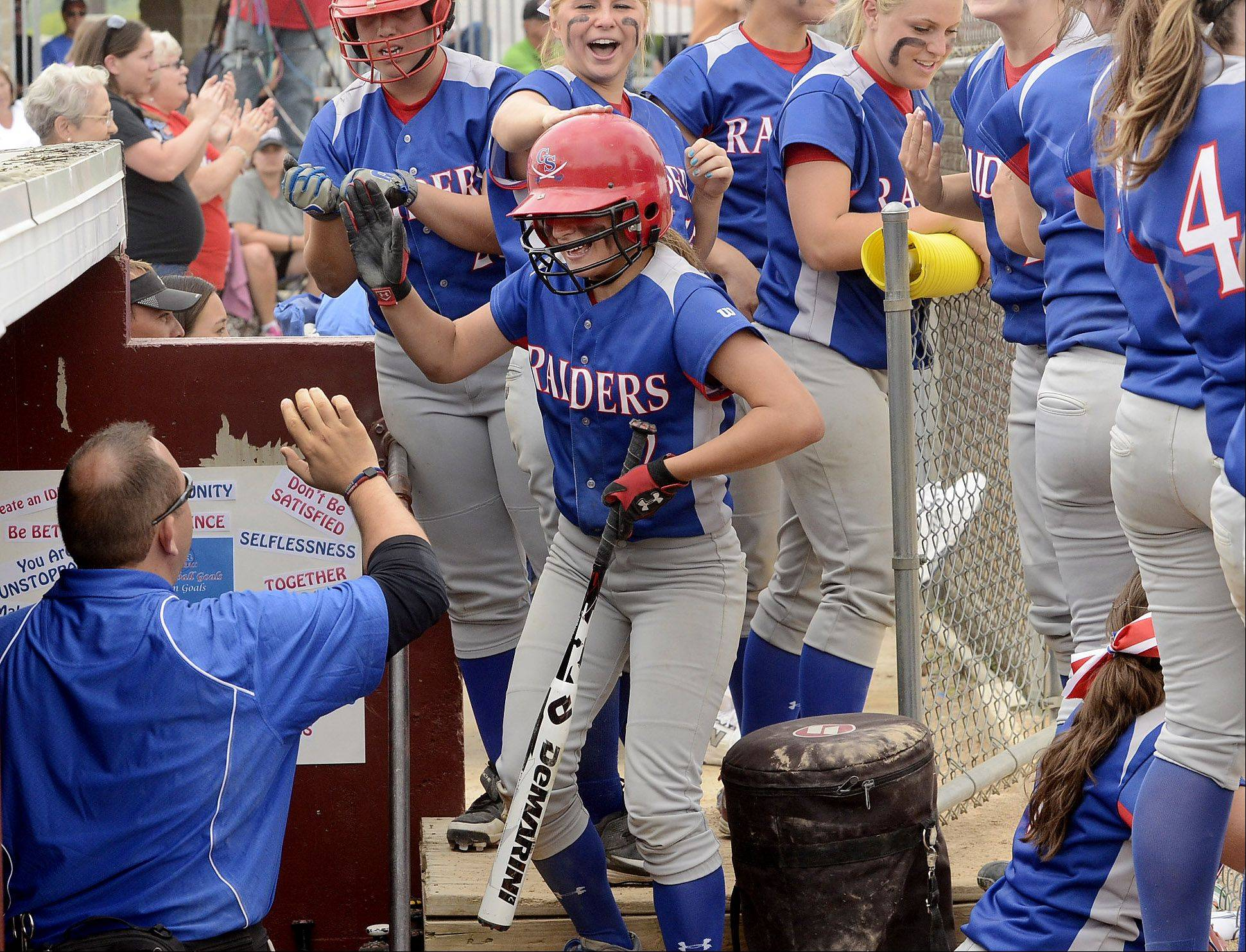 Payton Carli is congratulated after scoring Glenbard South's only run as the Raiders earned their second straight Class 3A softball state championship.