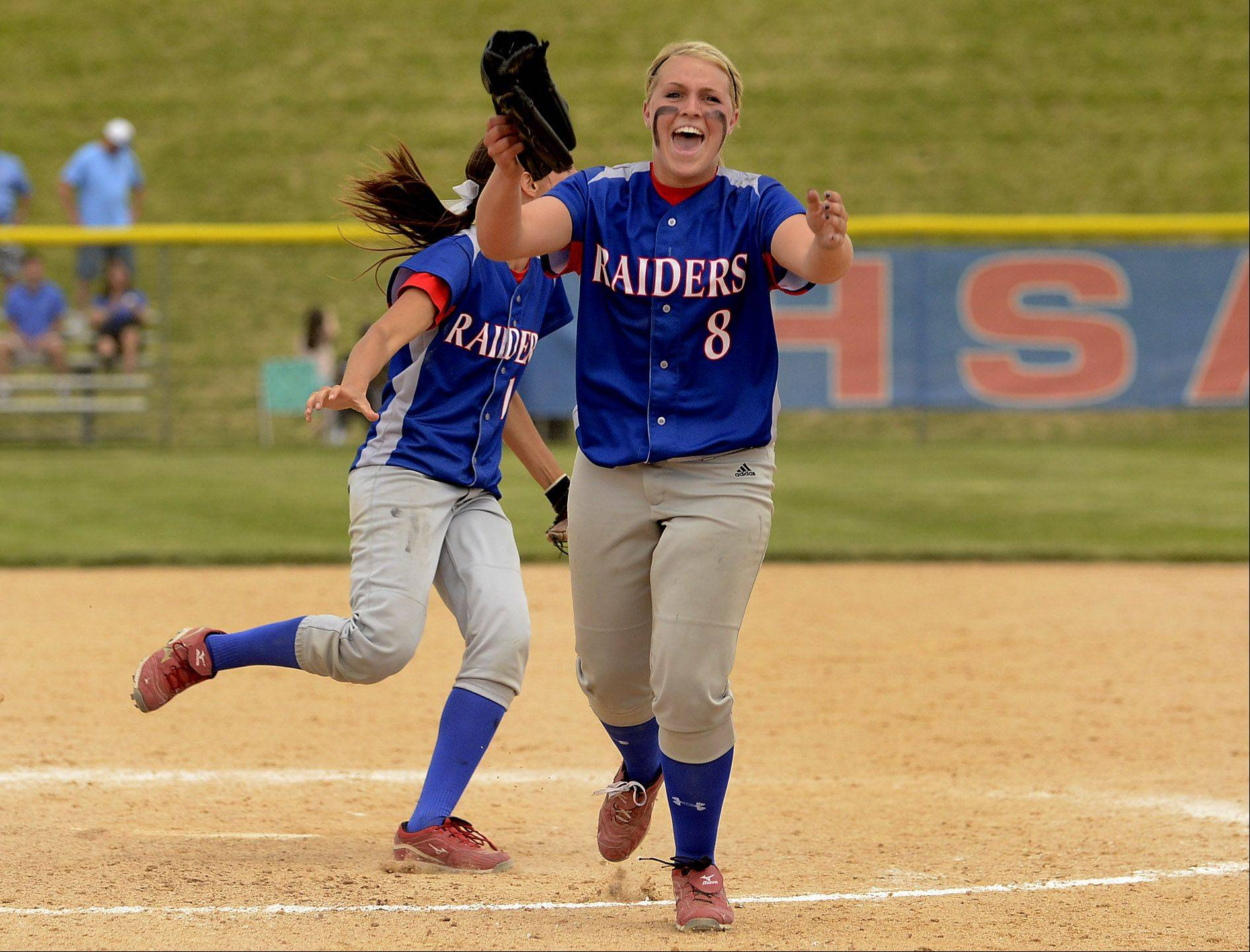Stephanie Chitkowski jumps for joy after the final out of the game as Glenbard South repeats as Class 3A softball state champions.
