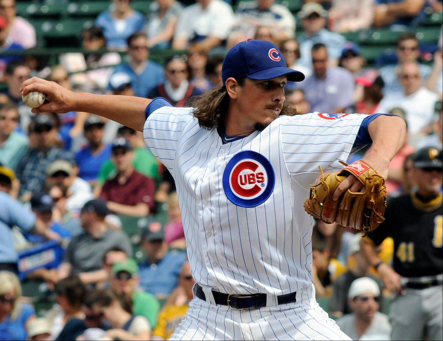 Chicago Cubs pitcher Jeff Samardzija delivers to a Pittsburgh Pirates batter during a baseball game on Saturday June 8, 2013, in Chicago, Ill.