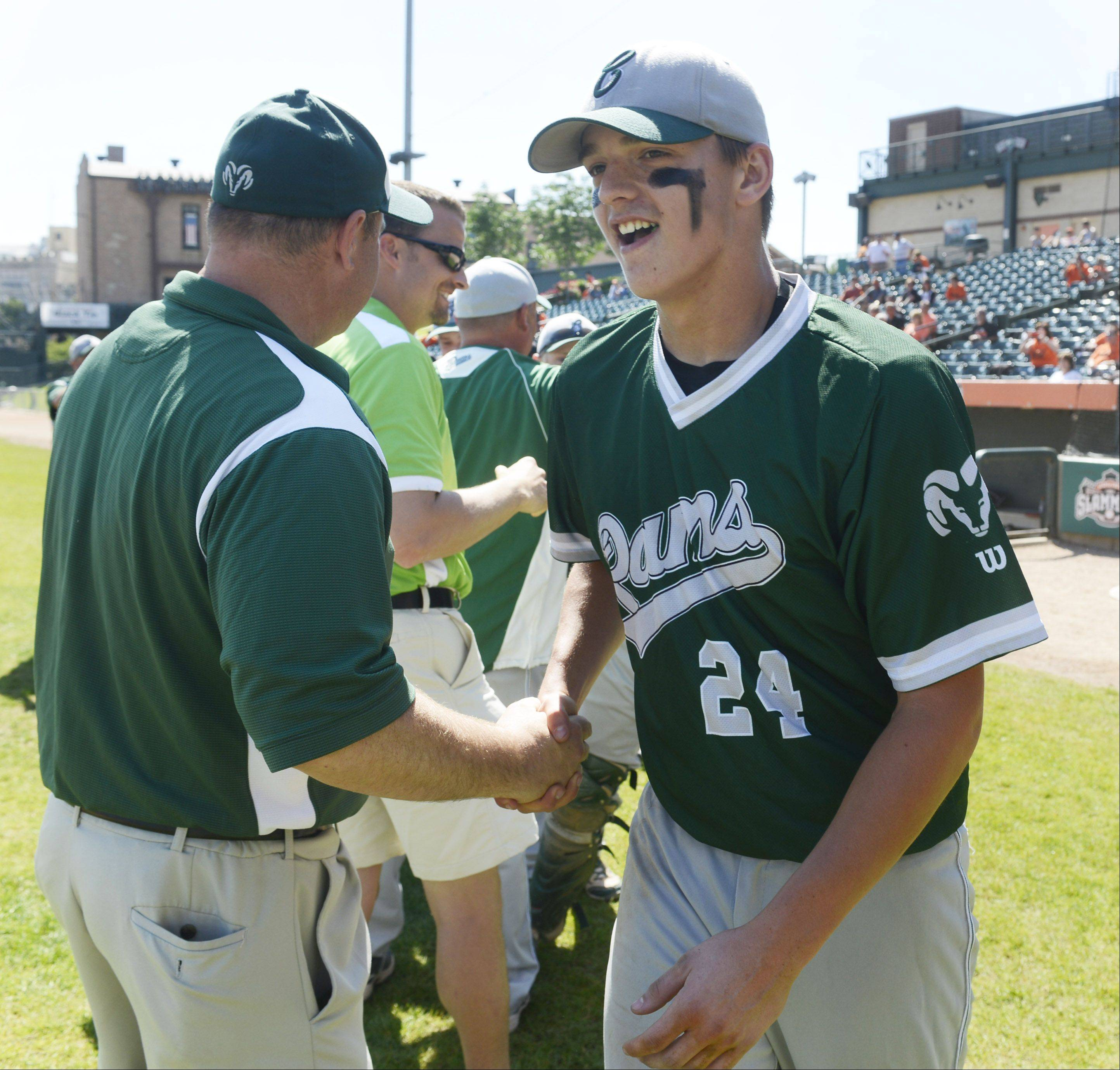 Grayslake Central's Kyle Clark and his teammates receive congratulations after the Rams beat Mt. Vernon 1-0 during the Class 3A state baseball third-place game at Silver Cross Field in Joliet Saturday.