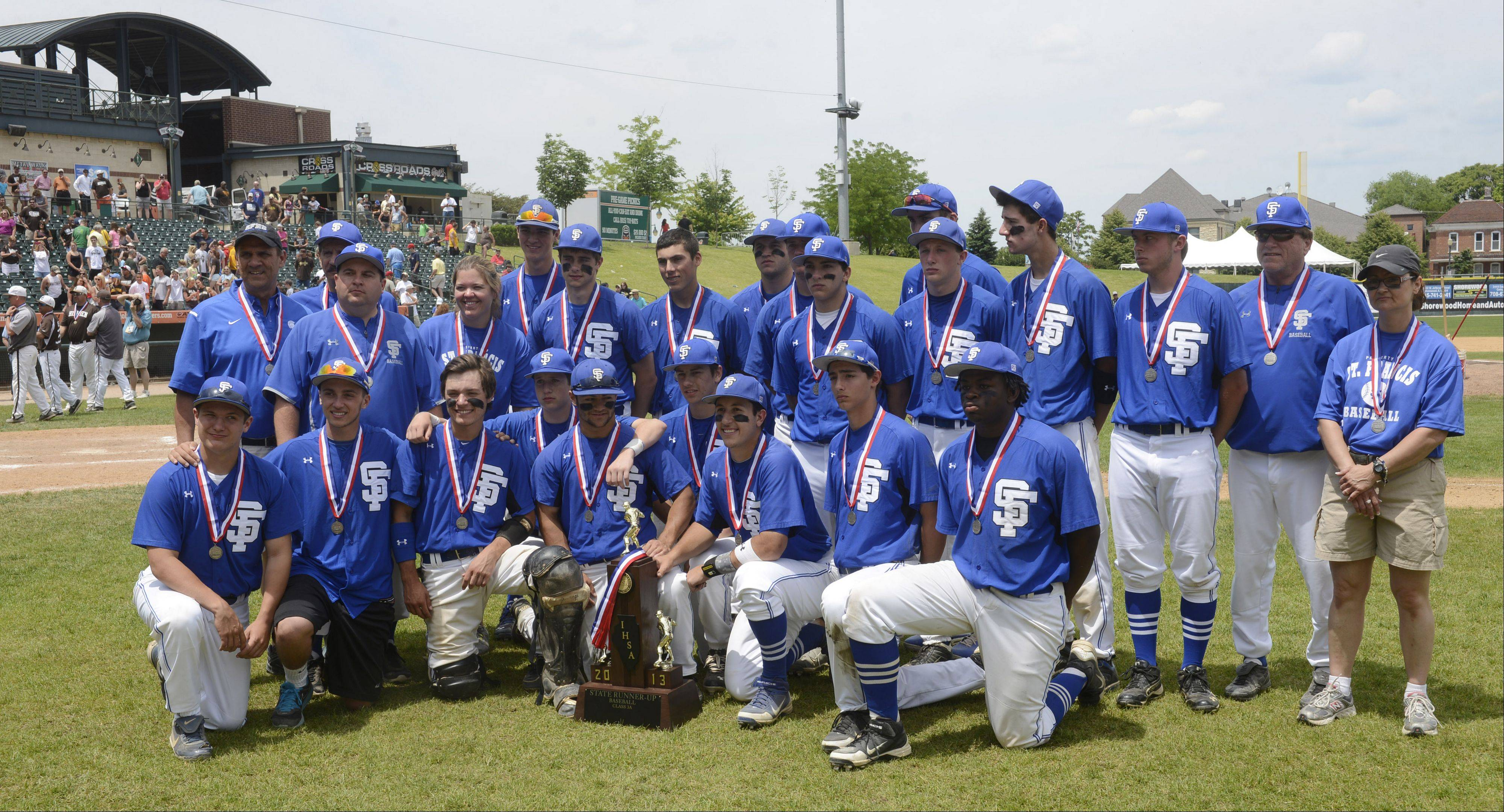 St. Francis players have their photo taken with the second-place trophy following their 5-0 loss to Joliet Catholic during the Class 3A state baseball championship game at Silver Cross Field in Joliet Saturday.