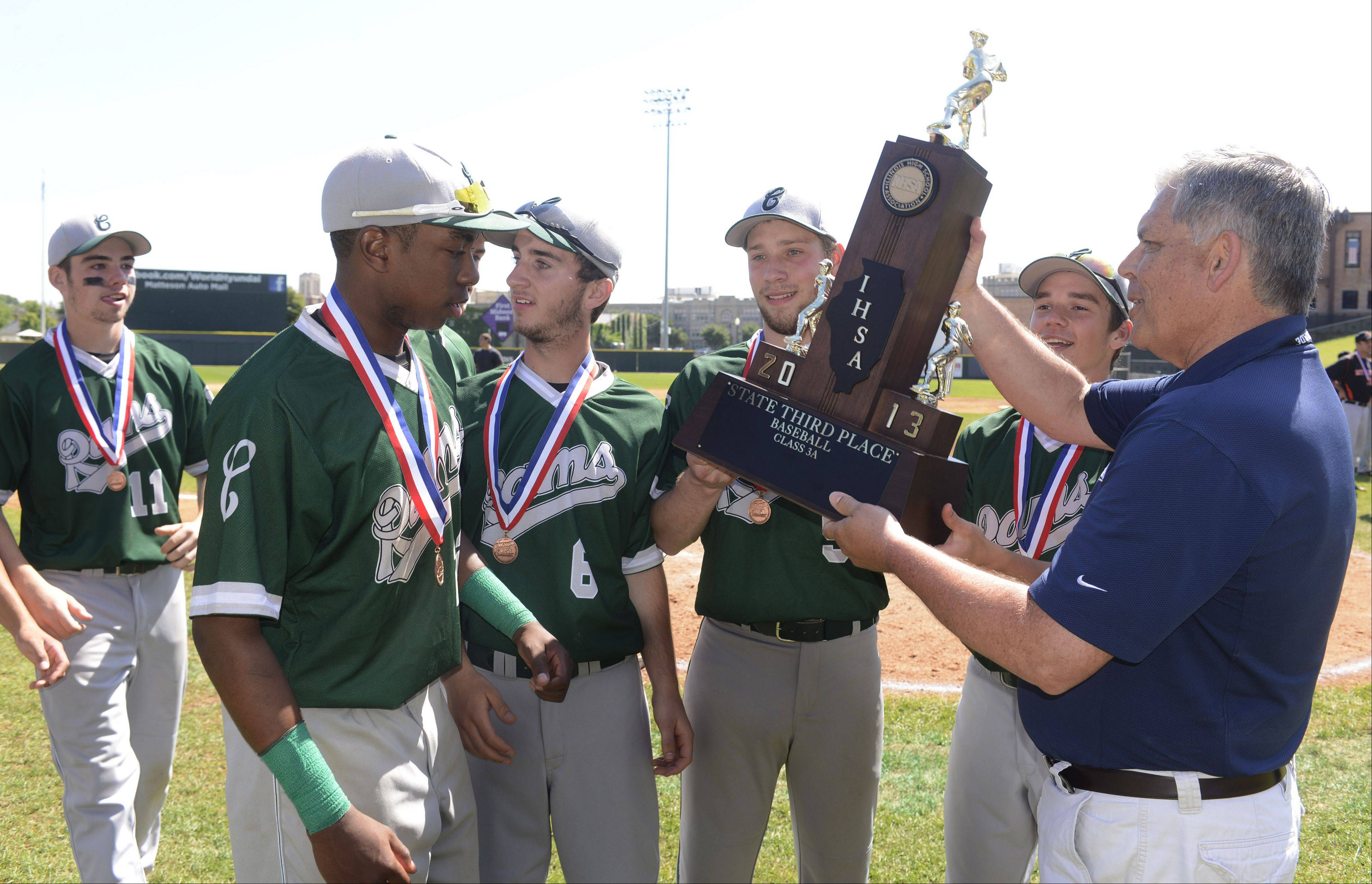 Grayslake Central players receive the trophy after their team beat Mt. Vernon 1-0 during the Class 3A state baseball third-place game at Silver Cross Field in Joliet Saturday.