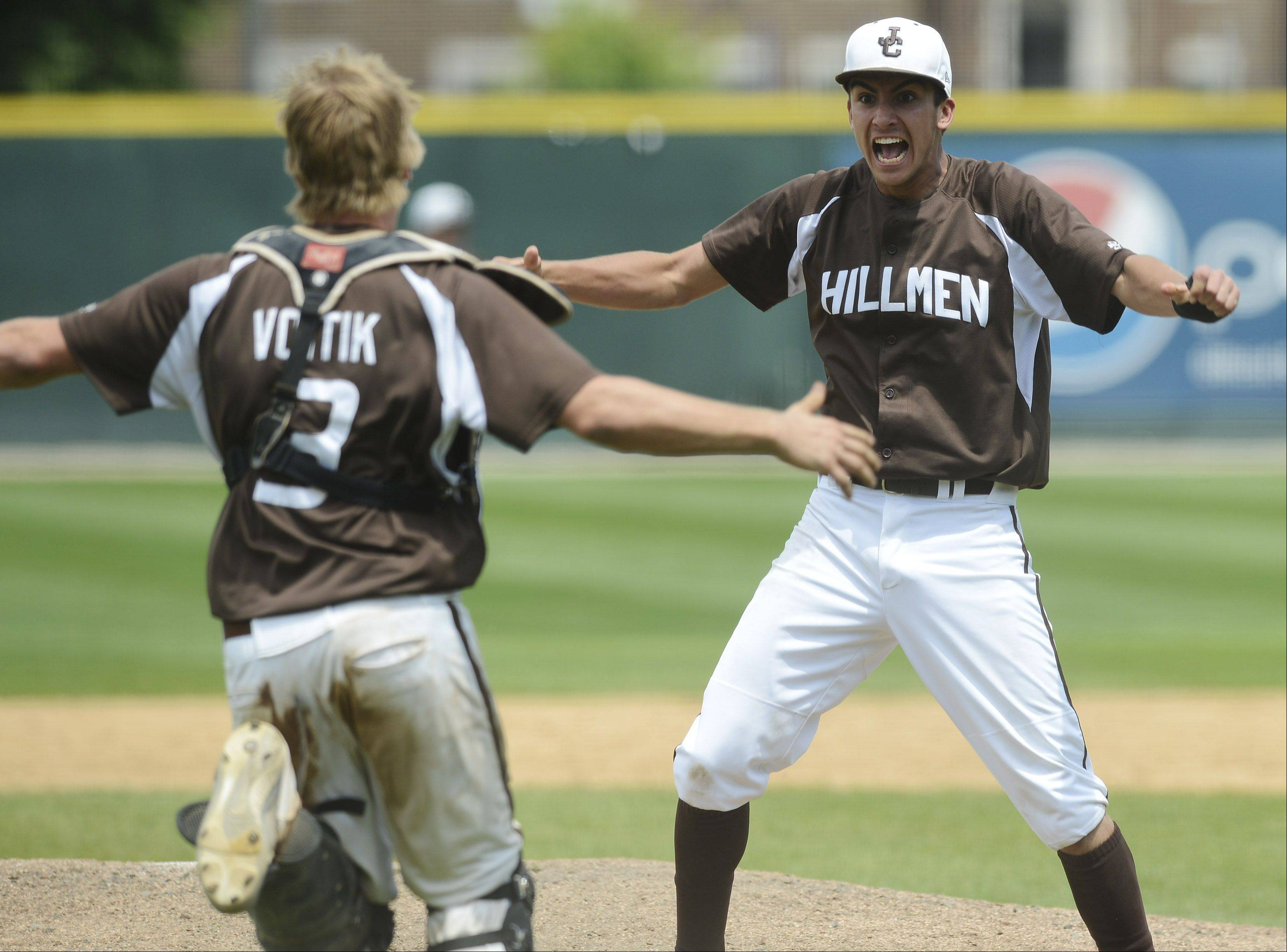 Joliet Catholic pitcher Nick Dalesandro celebrates with catcher Alex Voitik after getting the final out of his team's victory over St. Francis during the Class 3A state baseball championship game at Silver Cross Field in Joliet Saturday.