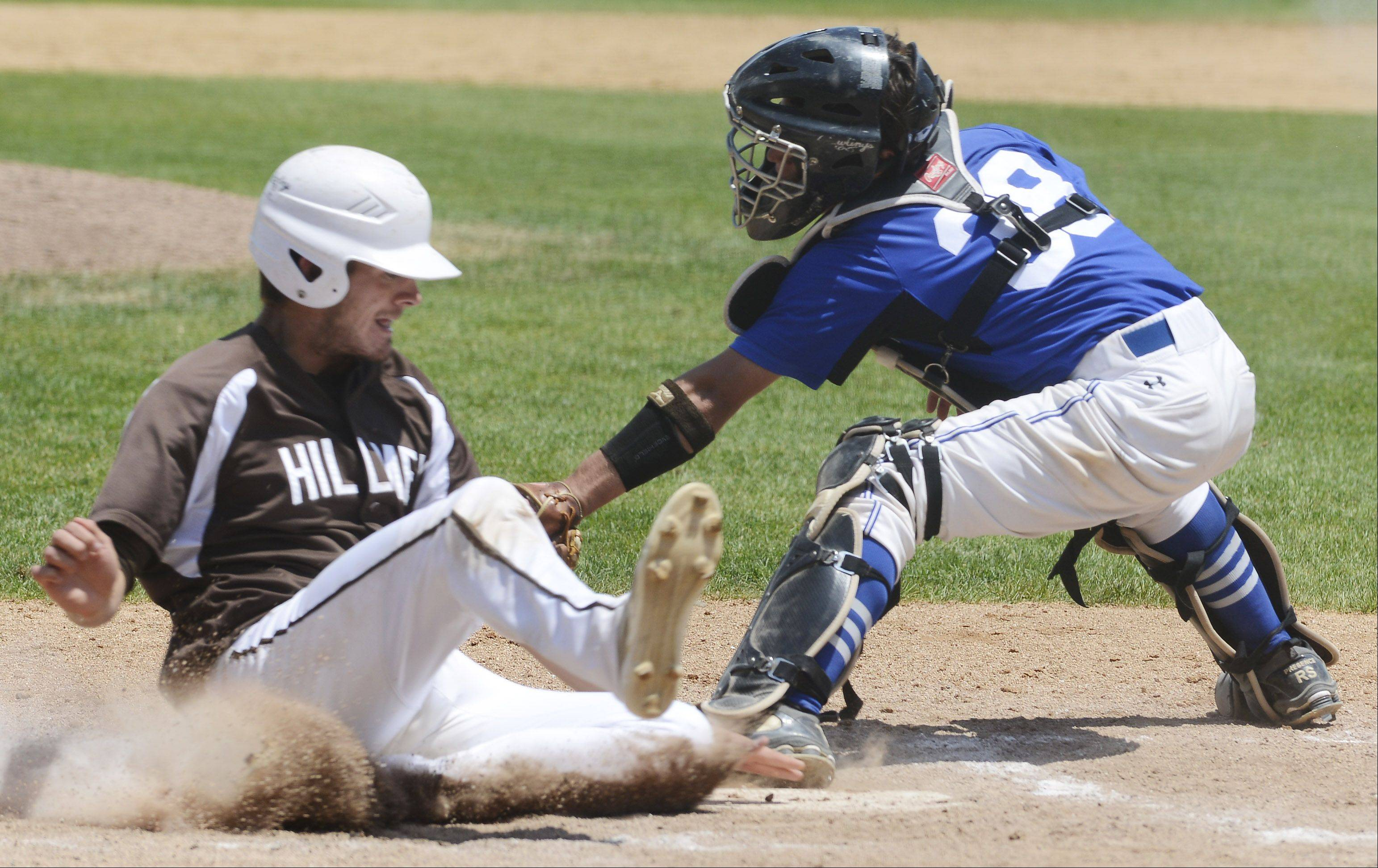 Joliet Catholic's Chris Tschida scores the Hilltoppers' second run of the fourth inning as St. Francis catcher Brett Jungles applies the tag during the Class 3A state baseball championship game at Silver Cross Field in Joliet Saturday.