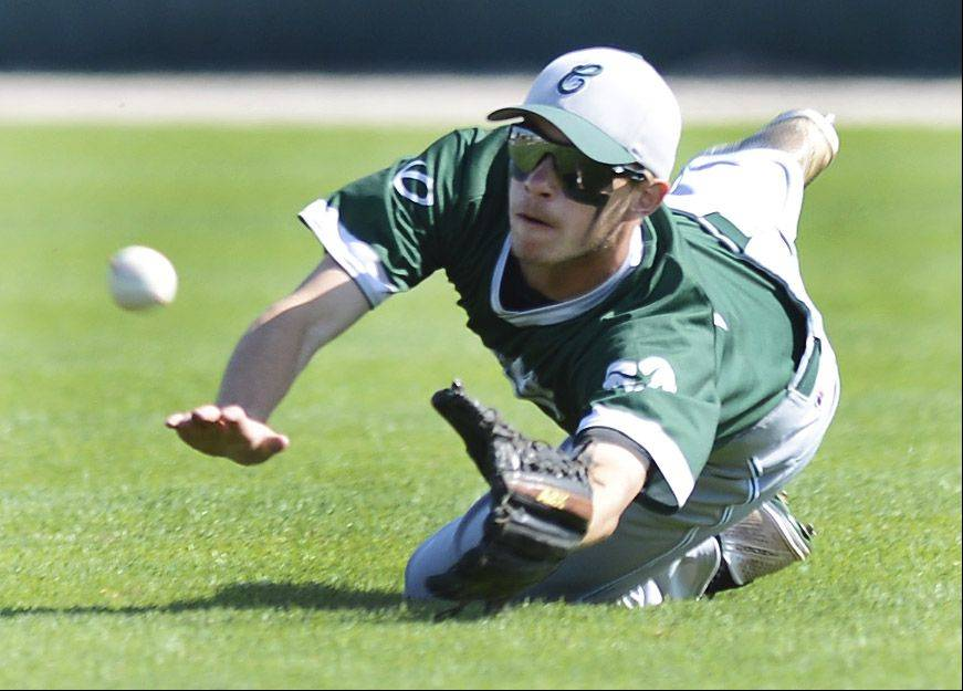 Grayslake Central center fielder Matt Loeffl makes a solid effort on a sinking line drive that went for a Mt. Vernon hit during the Class 3A state baseball third-place game at Silver Cross Field in Joliet Saturday.