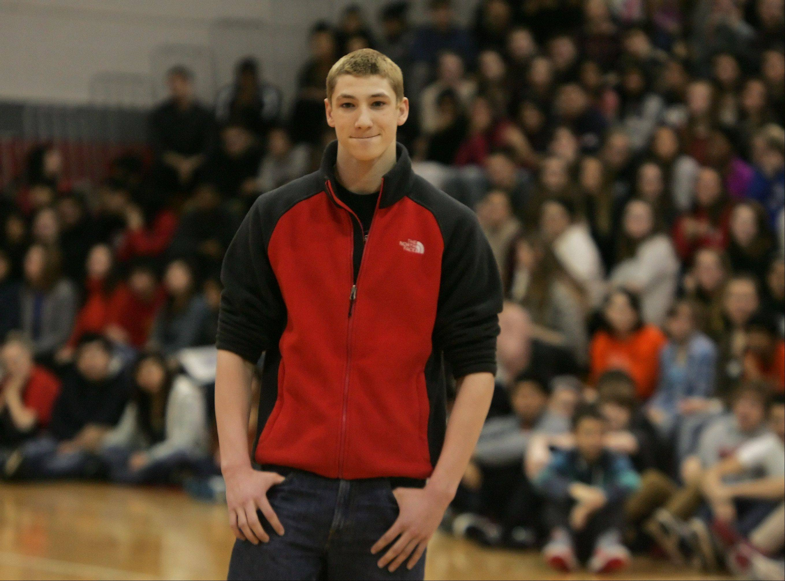 Connor Black is honored at an all-school assembly at Mundelein after breaking state and national records at the state swimming meet. Black, the Daily Herald's Lake County male athlete of the year, set a state record in the 50 freestyle and broke state and national records in the 100 butterfly.