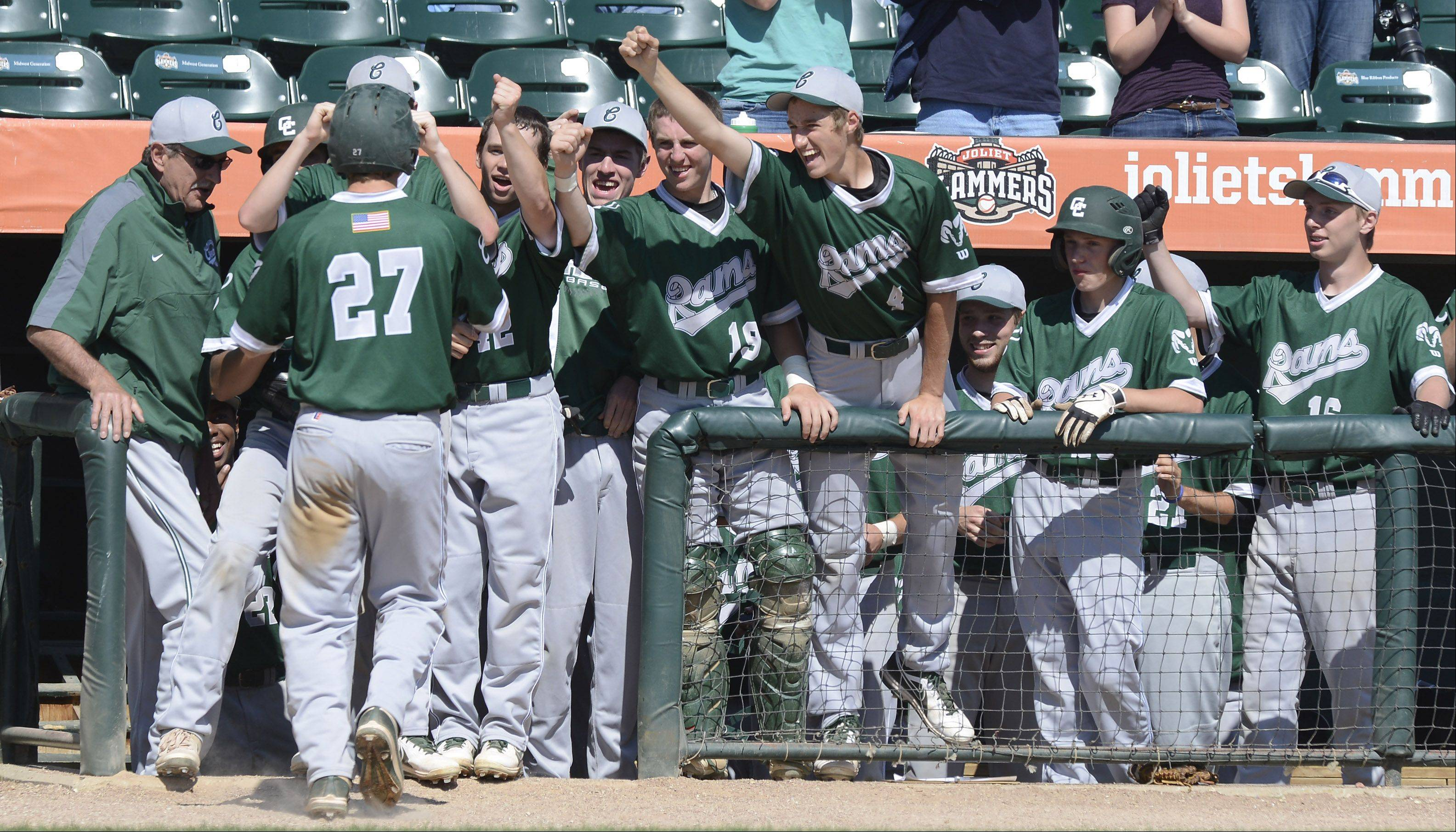 Grayslake Central players greet pinch runner Danny Reed as he returns to the dugout after scoring the game's lone run during the Class 3A state baseball third-place game against Mt. Vernon at Silver Cross Field in Joliet Saturday.