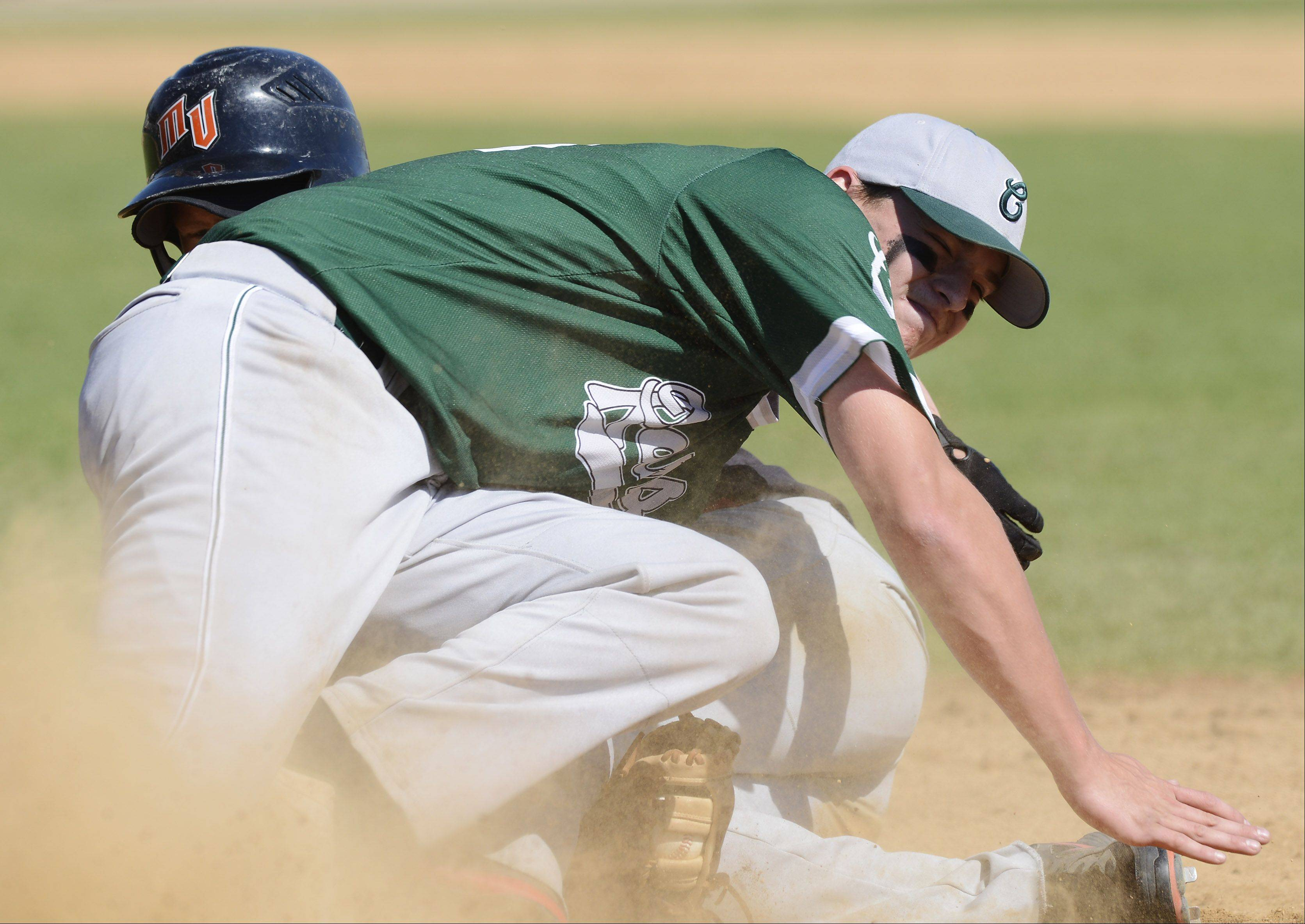 Grayslake Central first baseman Kyle Clark tags out Mt. Vernon's Jake Pike to complete an inning ending double play to end the top of the sixth inning during the Class 3A state baseball third-place game at Silver Cross Field in Joliet Saturday.