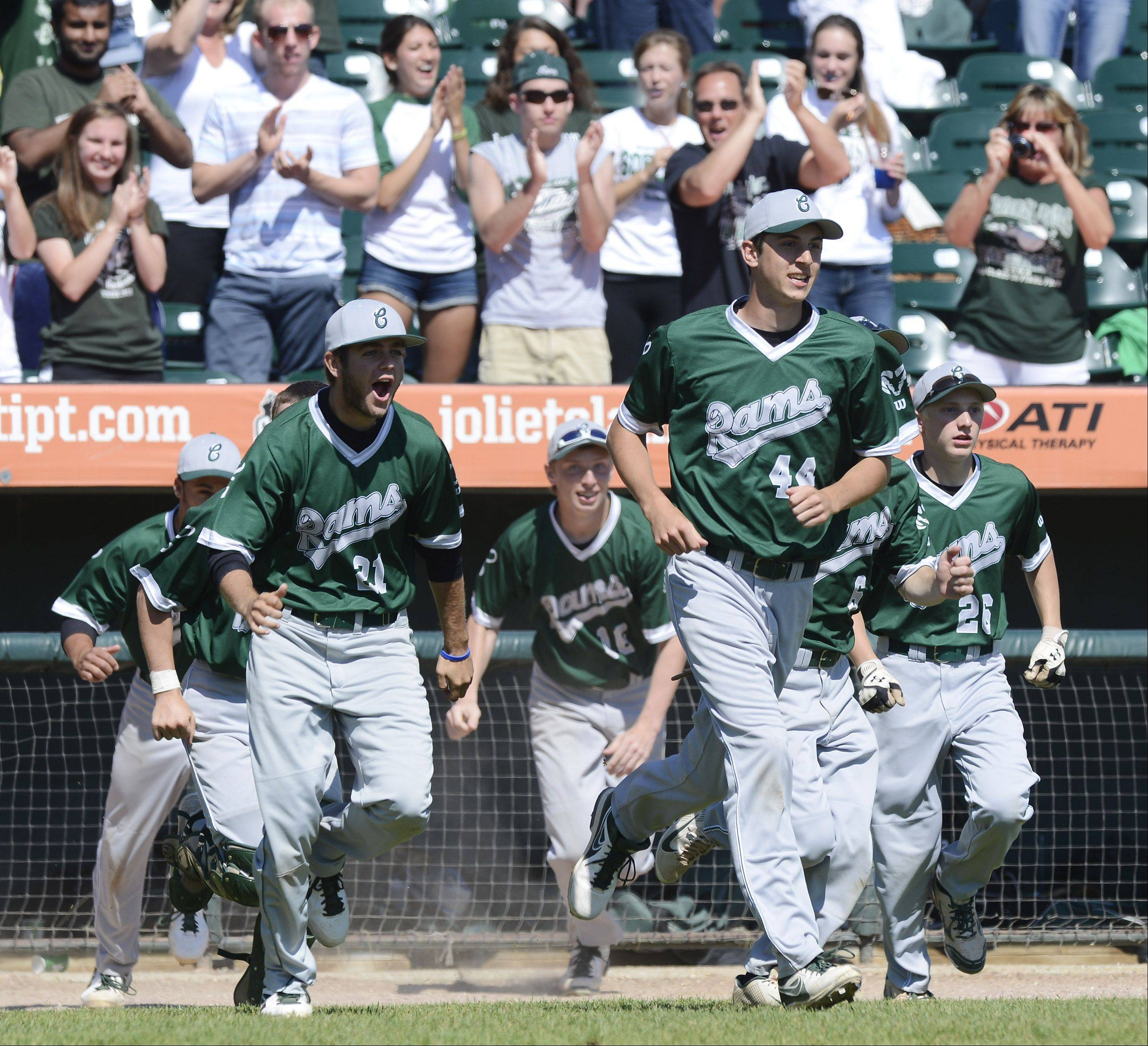Grayslake Central players charge onto the field after their team beat Mt. Vernon 1-0 during the Class 3A state baseball third-place game at Silver Cross Field in Joliet Saturday.
