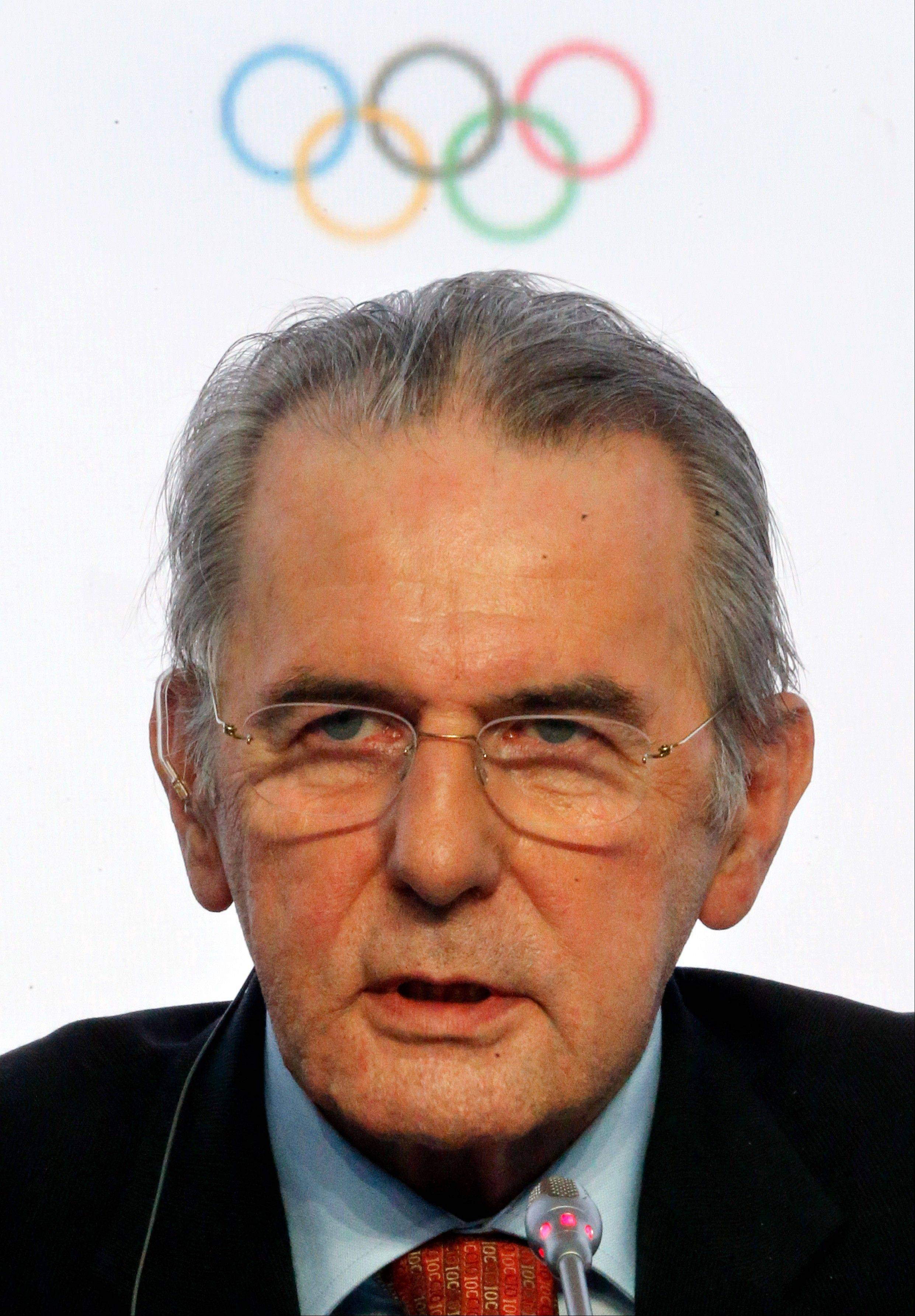 In this May 31, 2013, file photo, President of the International Olympic Committee (IOC) Jacques Rogge speaks during a news conference after an IOC executive board meeting at the SportAccord International Convention in St. Petersburg, Russia. Rogge's departure in September after 12 years as president has created the opportunity for power plays around the Olympic world. Organizations and individuals are staking out positions and forging alliances, each trying to secure a place in the shifting landscape.