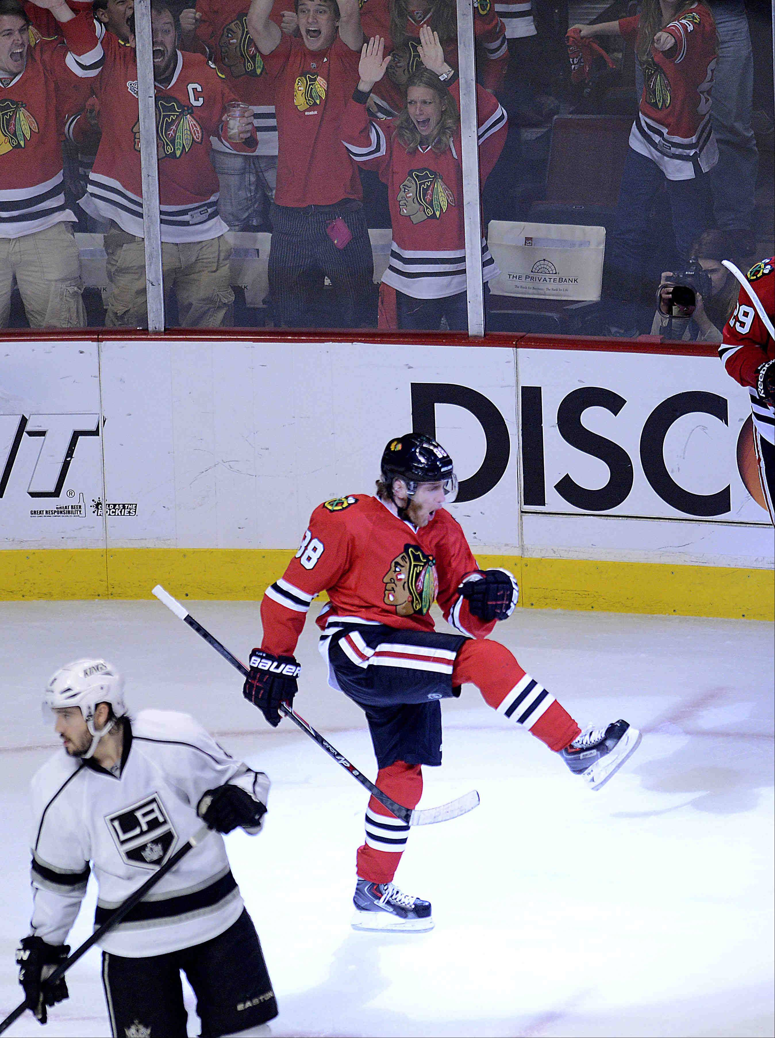 Chicago Blackhawks right wing Patrick Kane reacts after his goal with less than four minutes left in regulation against the Los Angeles Kings Saturday during the NHL Western Conference Finals Game 5 at the United Center in Chicago.