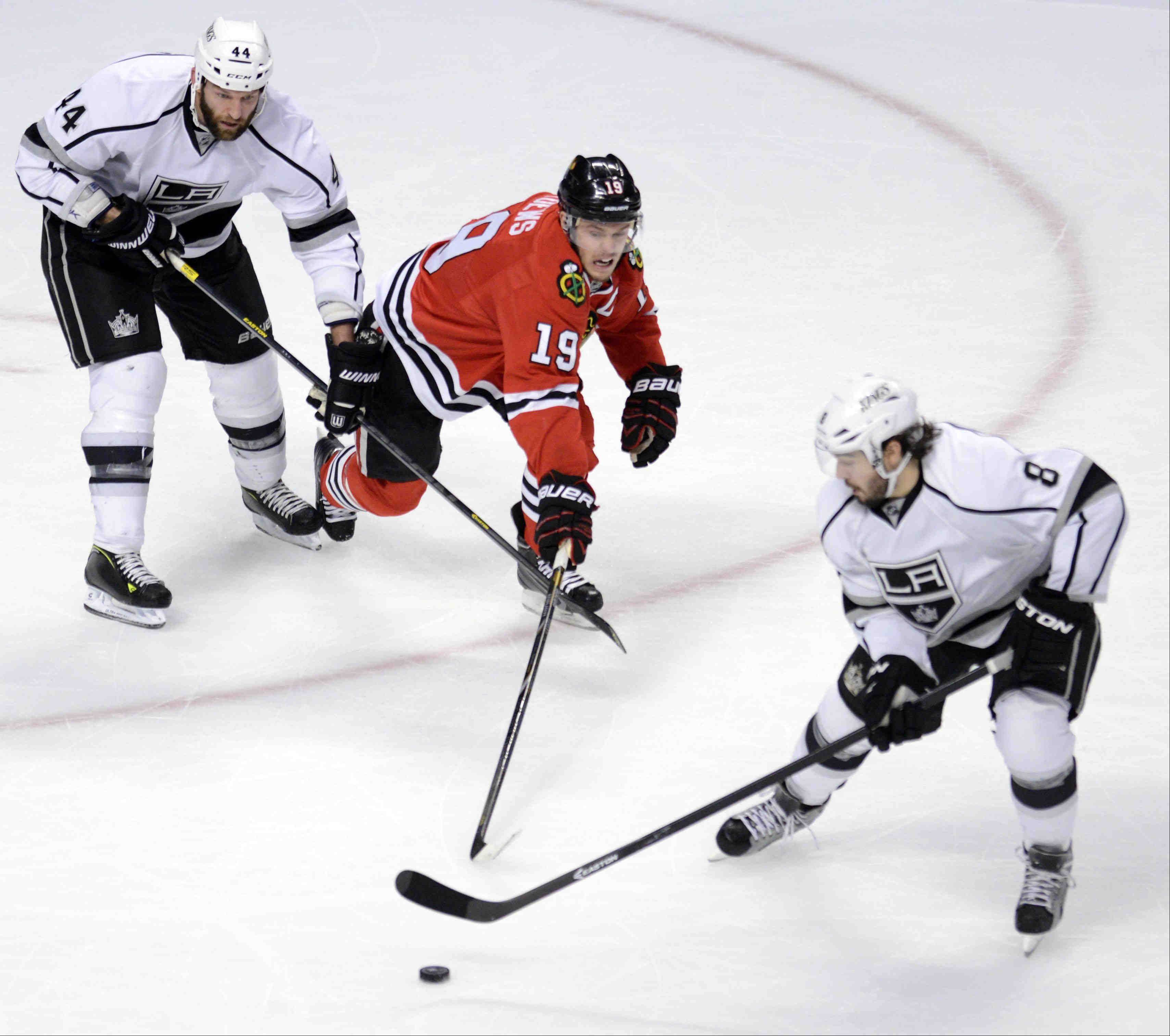Chicago Blackhawks center Jonathan Toews is double teamed by Los Angeles Kings defenseman Robyn Regehr and Drew Doughty Saturday during the NHL Western Conference Finals Game 5 at the United Center in Chicago.