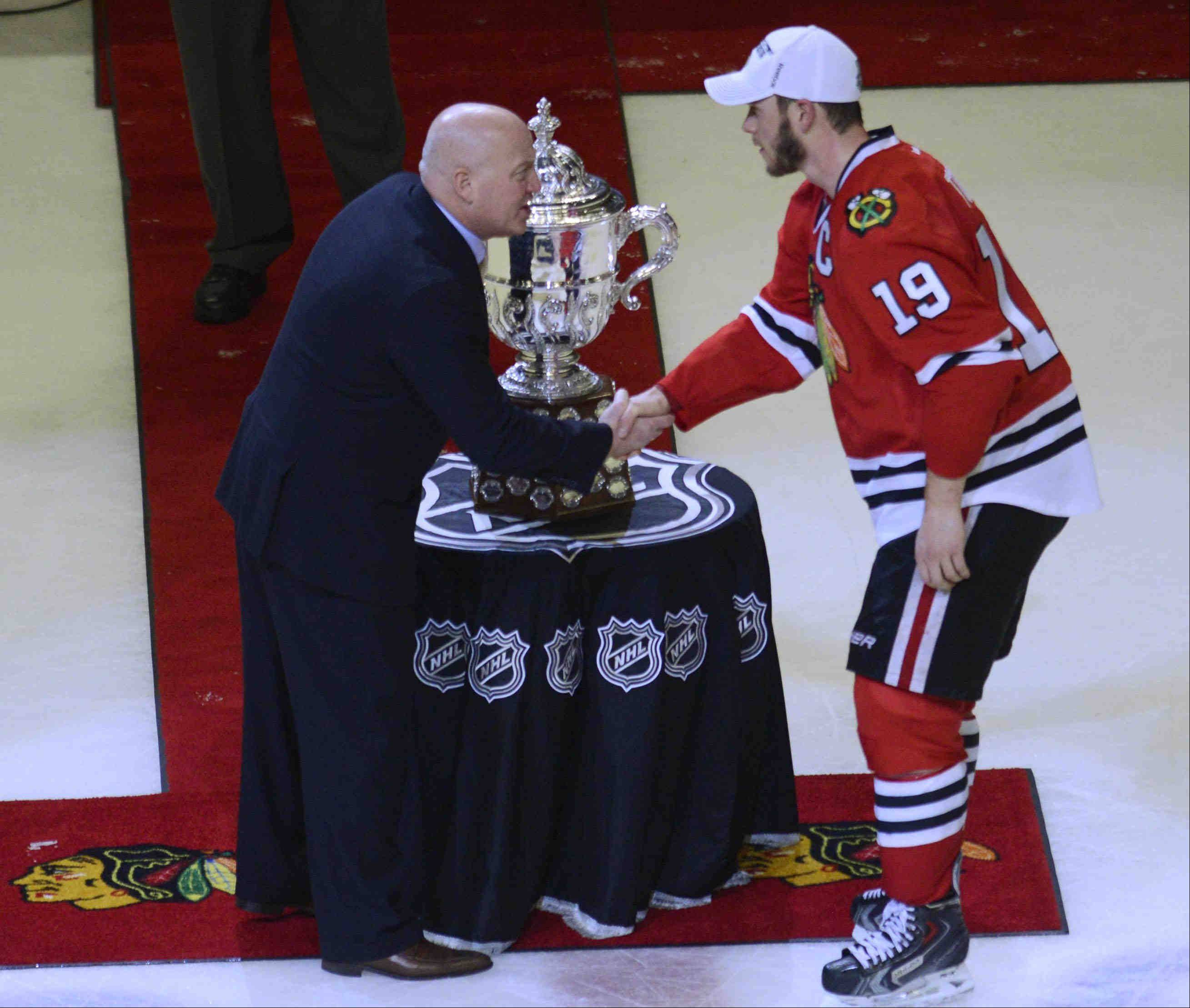 Chicago Blackhawks captain Jonathan Toews accepts, but doesn't touch, the Campbell Cup after defeating the Los Angeles Kings Saturday for the NHL Western Conference Championship at the United Center in Chicago.