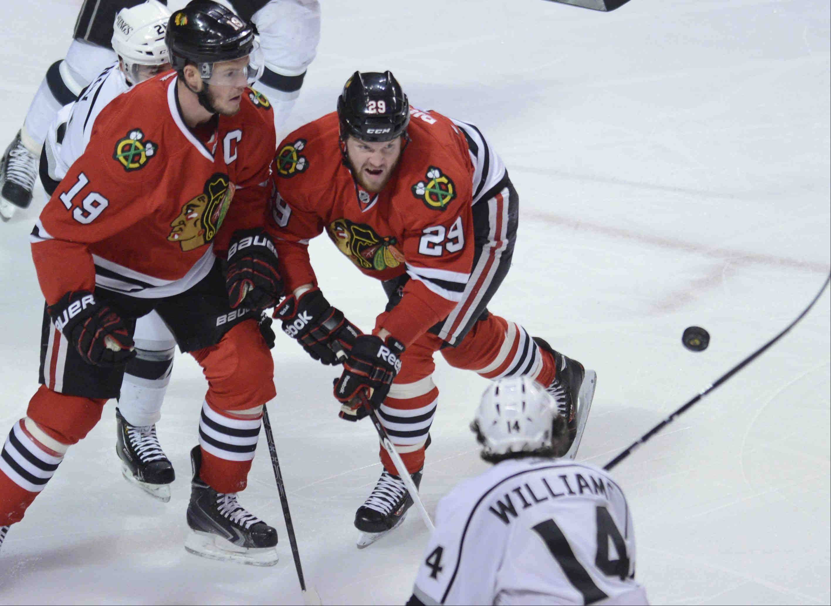 Chicago Blackhawks center Jonathan Toews and Bryan Bickell compete with Los Angeles Kings right wing Justin Williams for the puck in the first period Saturday during the NHL Western Conference Finals Game 5 at the United Center in Chicago.