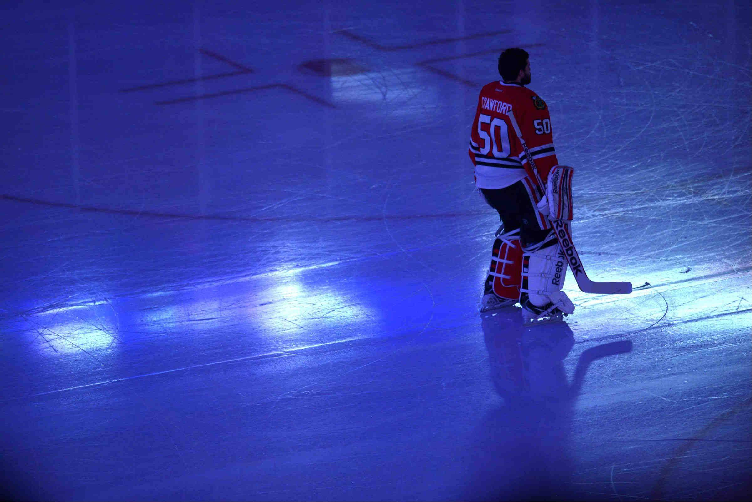 Chicago Blackhawks goalie Corey Crawford stands for the National Anthem Saturday during the NHL Western Conference Finals Game 5 at the United Center in Chicago.