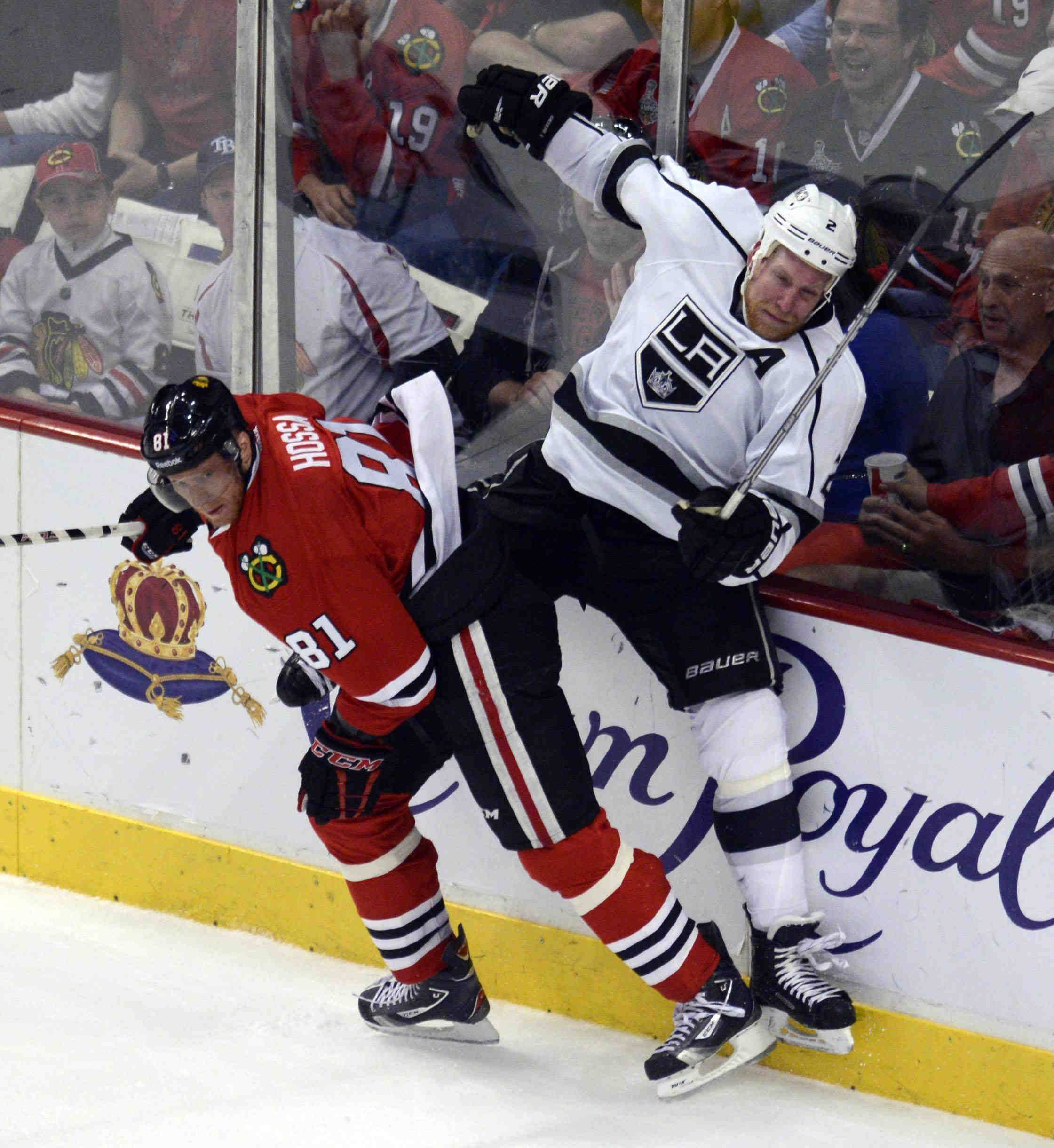 Chicago Blackhawks right wing Marian Hossa checks Los Angeles Kings defenseman Matt Greene into the boards Saturday during the NHL Western Conference Finals Game 5 at the United Center in Chicago.