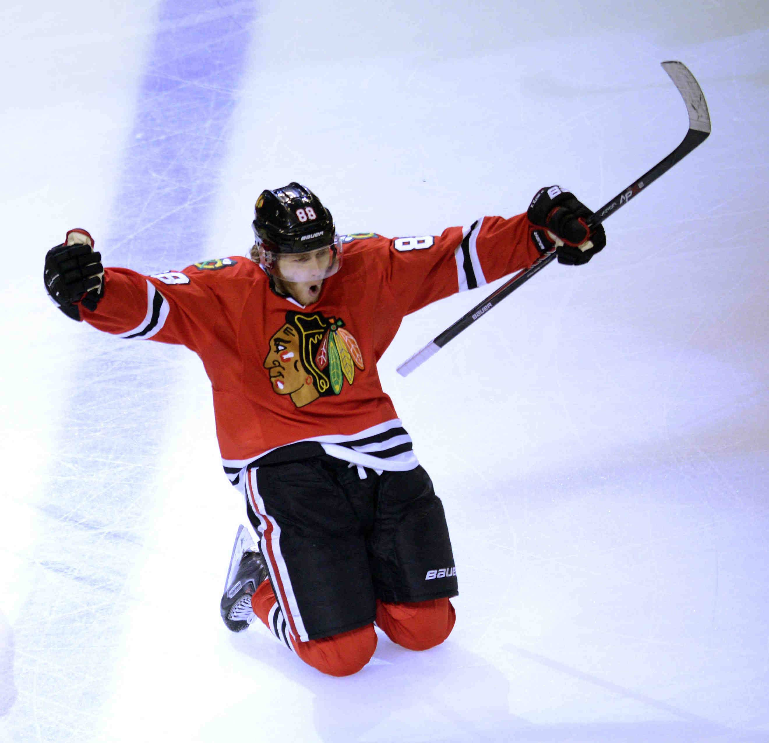 Chicago Blackhawks right wing Patrick Kane slides on his knees after scoring in double overtime to win the NHL Western Conference Finals Game 5 Saturday at the United Center in Chicago.