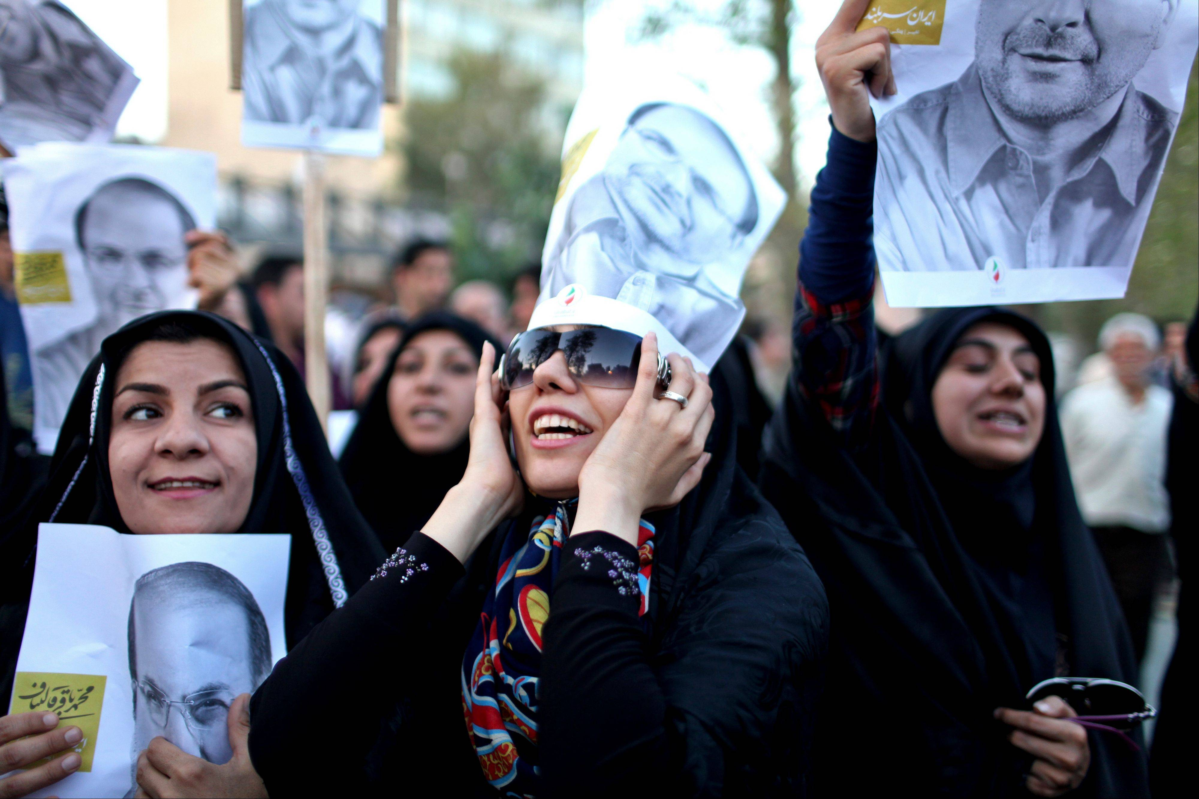 Supporters of Iranian presidential candidate Mohammad Bagher Qalibaf, who is also Tehran�s mayor, chant slogans, as they hold his posters, during a street campaign in Tehran Sunday.