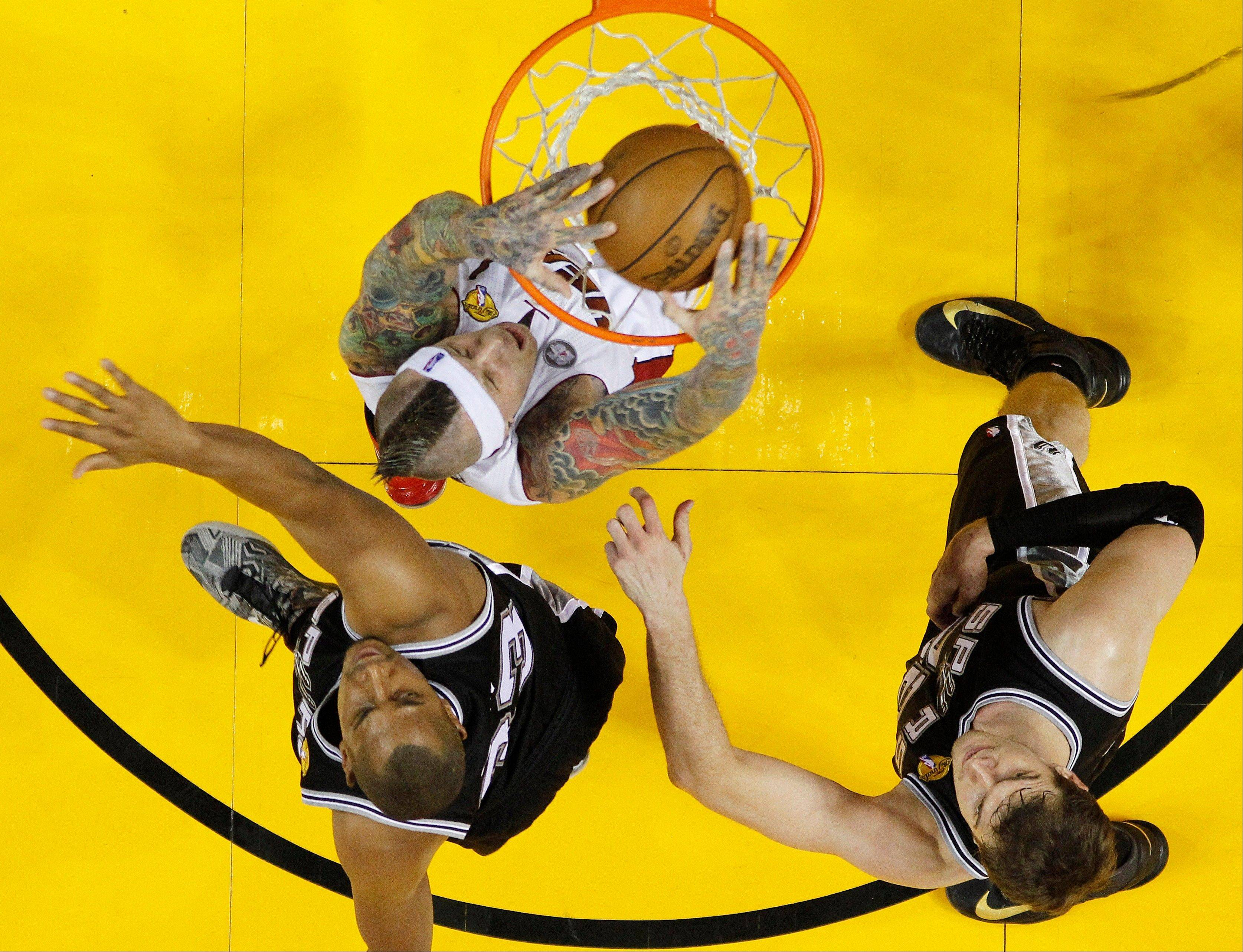Miami Heat power forward Chris Andersen dunks the ball Sunday as San Antonio's Boris Diaw and Tiago Splitter look on during the first half of Game 2 of the NBA Finals.