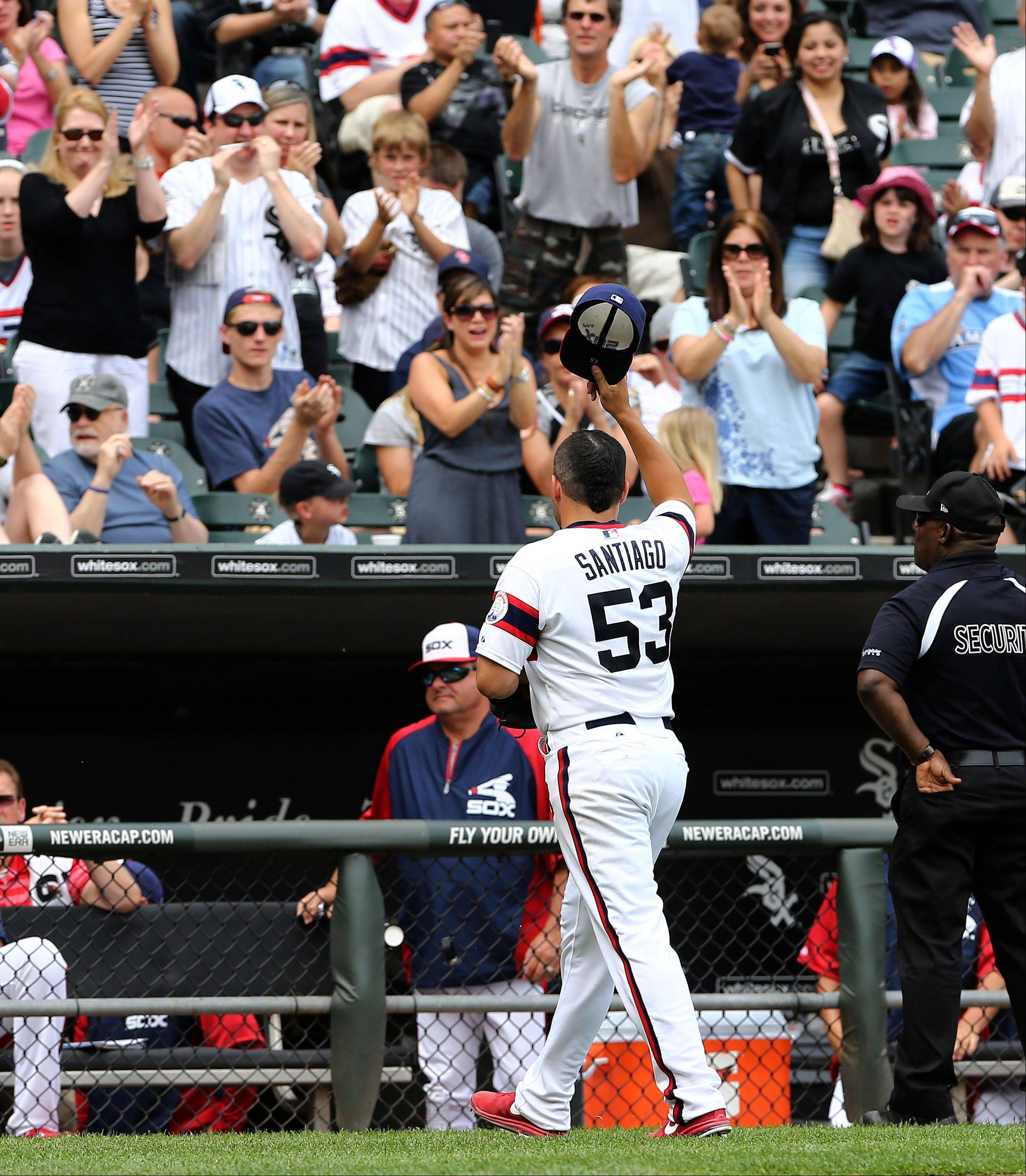 Starter Hector Santiago tips his hat to the fans after leaving the game in the seventh inning Sunday against the Athletics at U.S. Cellular Field. The 25-year-old lefty is 4-2 after earning the win, allowing 2 runs (1 earned) on 4 hits in 61⁄3 innings.