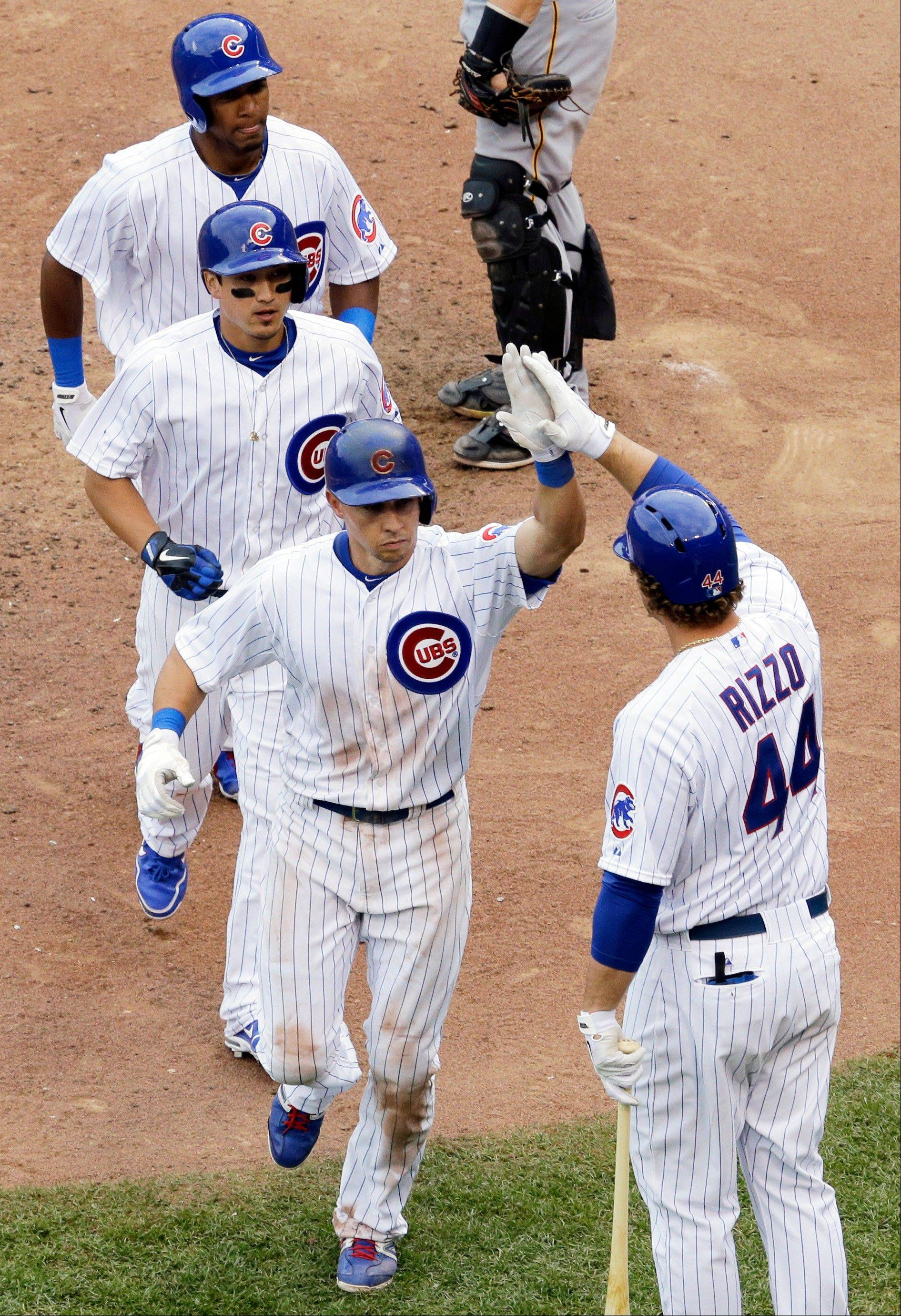 Cubs' Cody Ransom, front left, celebrates with teammate Anthony Rizzo after hitting a three-run home run during the seventh inning of a baseball game against the Pittsburgh Pirates, Sunday, June 9, 2013, in Chicago.
