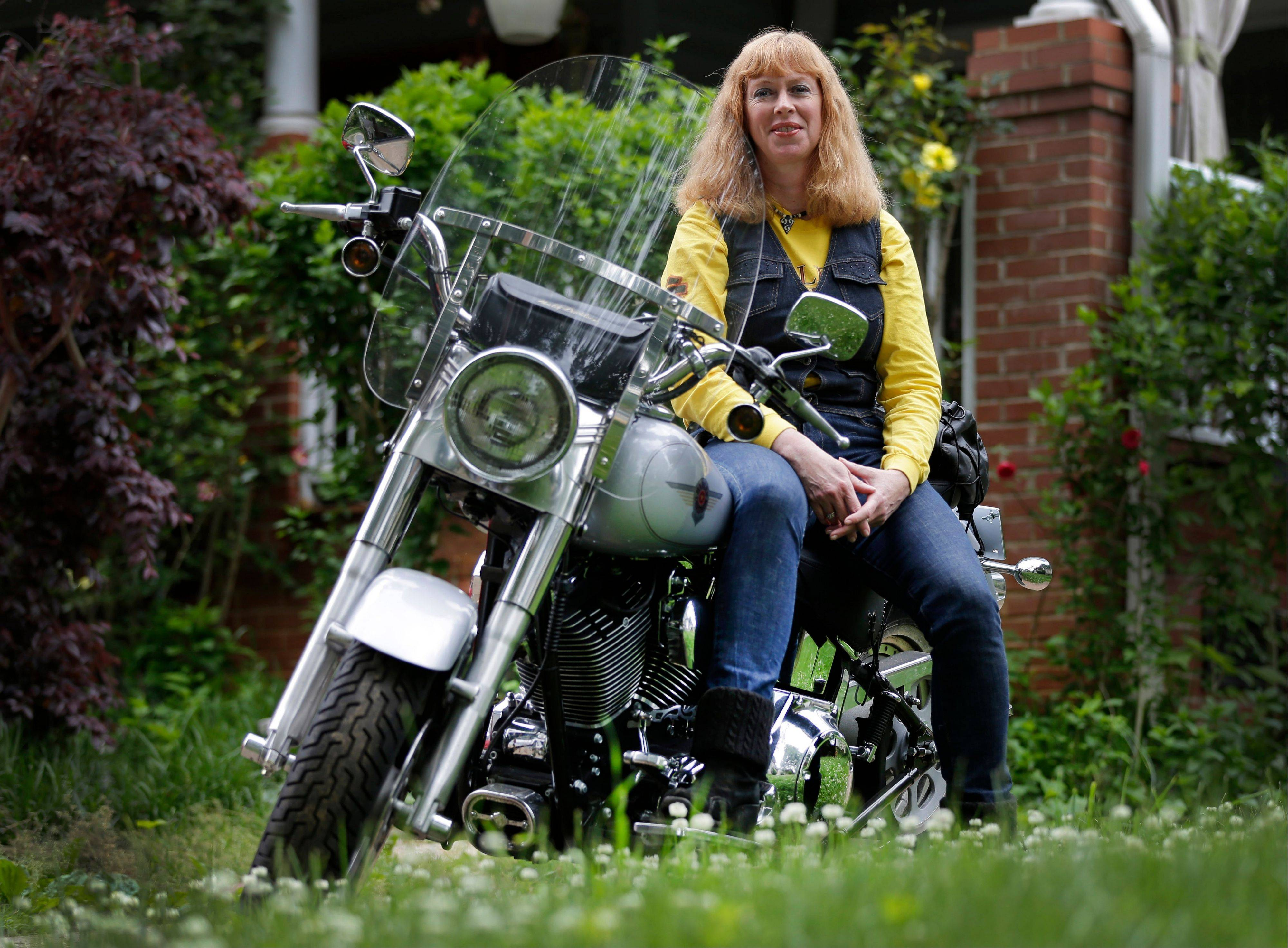 Crystal Swift poses on her Fat Boy Harley-Davidson at her home in Charlotte, N.C. Harley is the top seller of motorcycles in its class in the U.S. and leads in sales among women, minorities and younger adults as well as the middle-aged men.