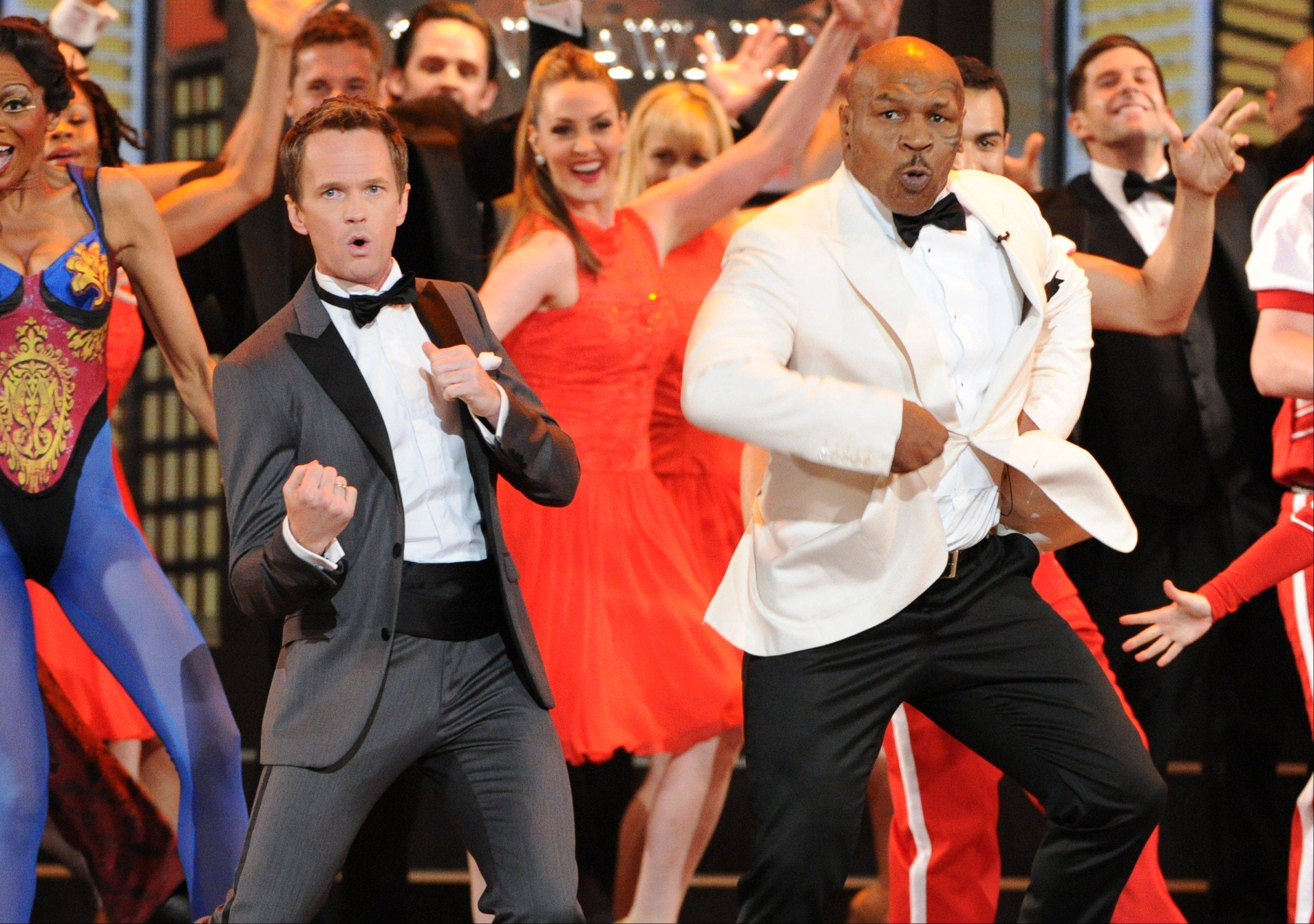 Actor Neil Patrick Harris, left, and Mike Tyson perform during the opening number Sunday at the 67th Annual Tony Awards in New York.