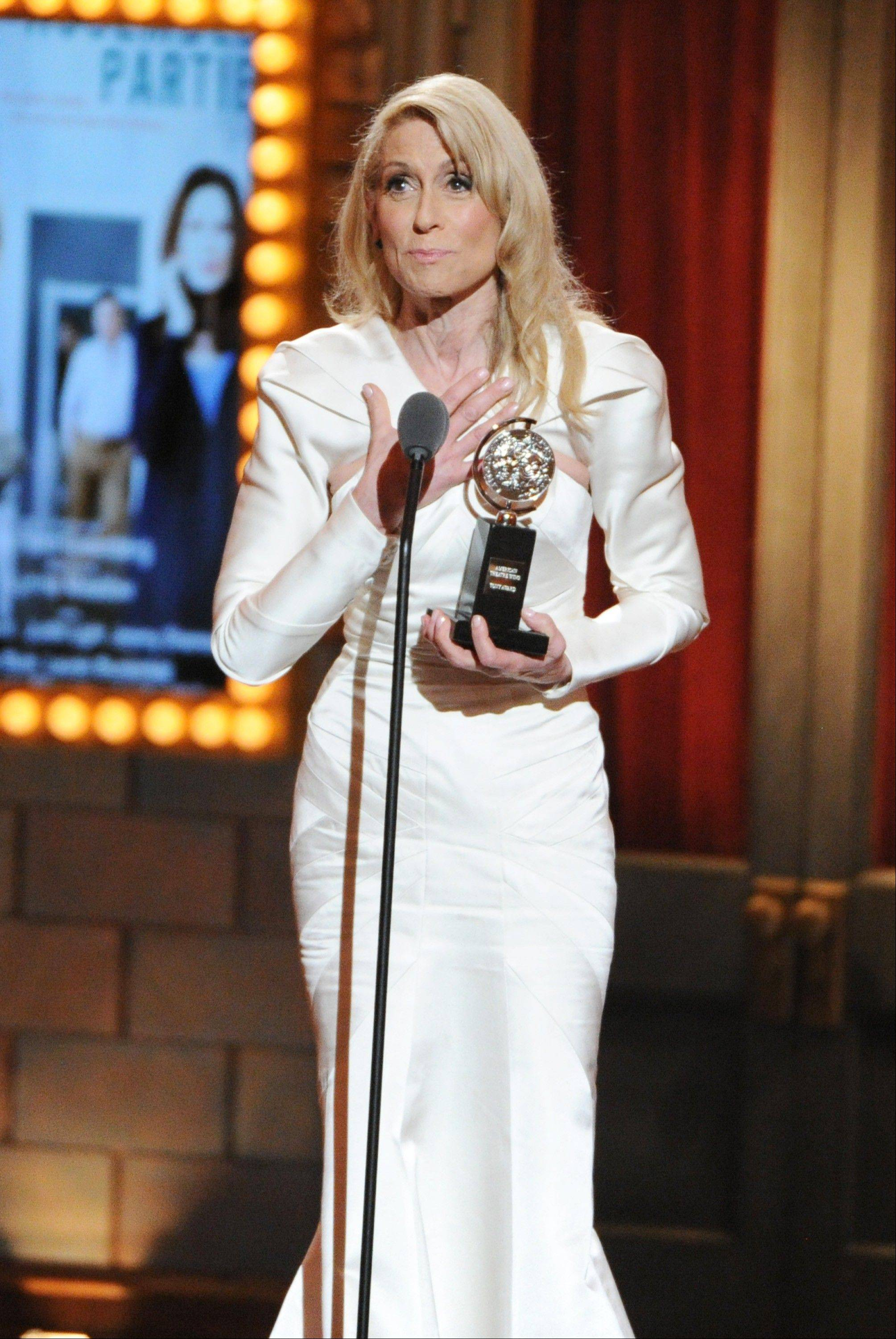 "Actress Judith Light accepts the award for Best Performance by an actress in a featured role in a play for her role in ""The Assembled Parties,"" at the 67th Annual Tony Awards, on Sunday, June 9, 2013 in New York."
