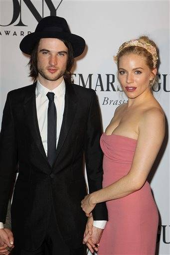 Actors Tom Sturridge and Sienna Miller arrive for the Tony Awards on Sunday night in New York.