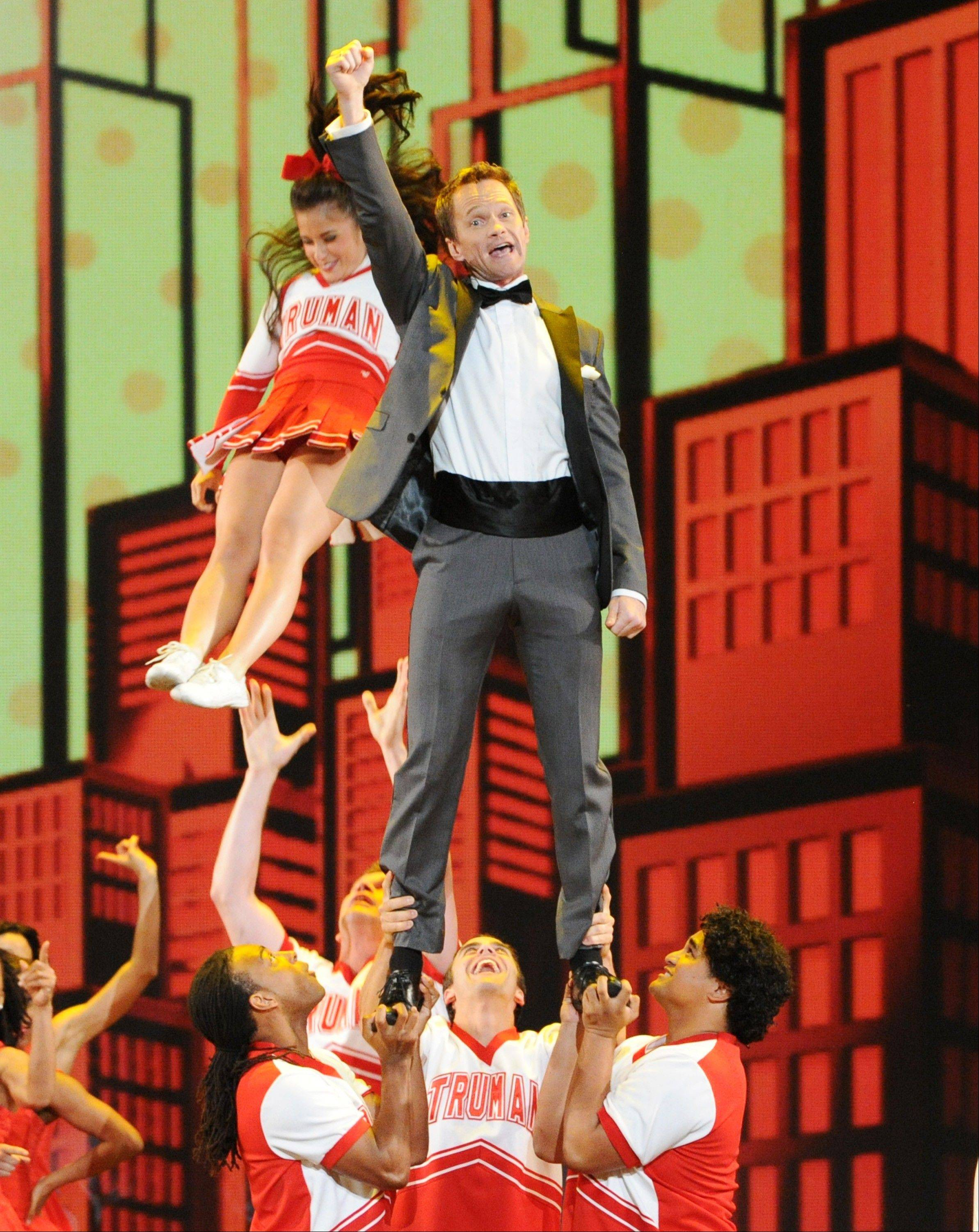 Actor Neil Patrick Harris performs on stage during his opening number at the 67th Annual Tony Awards, on Sunday, June 9, 2013 in New York.