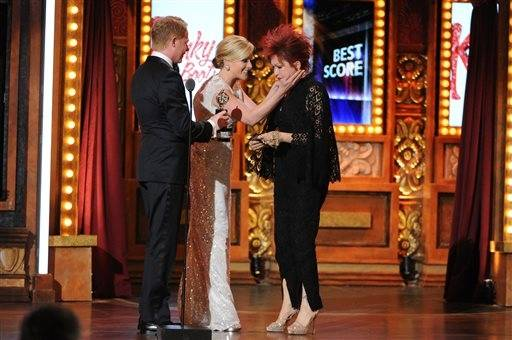 "Cyndi Lauper accepts the award for best score for ""Kinky Boots"" from Jesse Tyler Ferguson and Jane Krakowski."