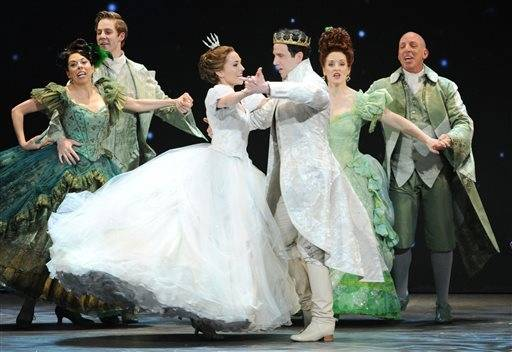 "Laura Osnes, left, performs with Santino Fontana and the rest of the cast of ""Rodgers+ Hammerstein's Cinderella"" at the Tonys."