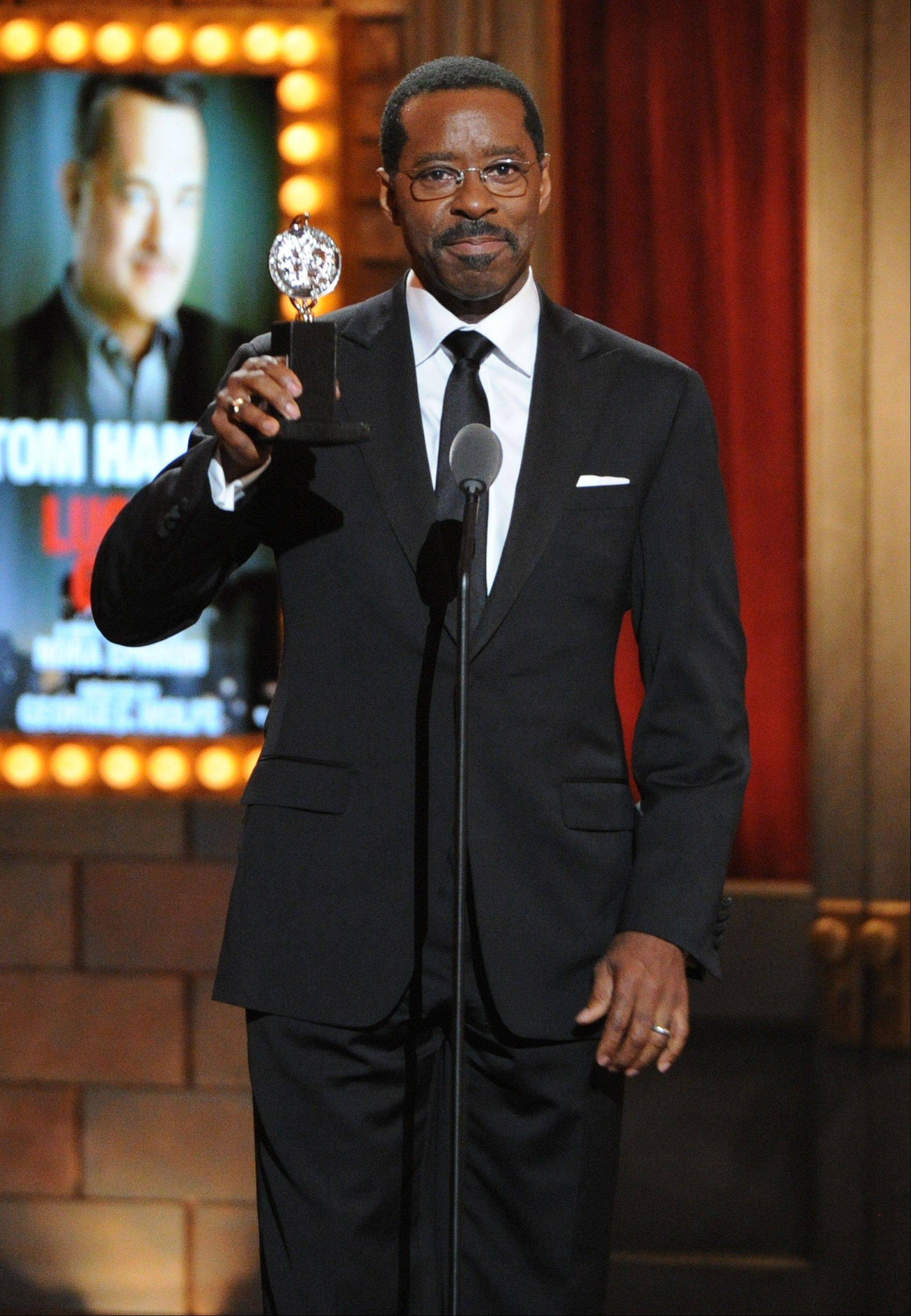 "Courtney B. Vance accepts the award for best featured actor in a play for Nora Ephron's ""Lucky Guy"" at the 67th Annual Tony Awards, on Sunday, June 9, 2013 in New York."