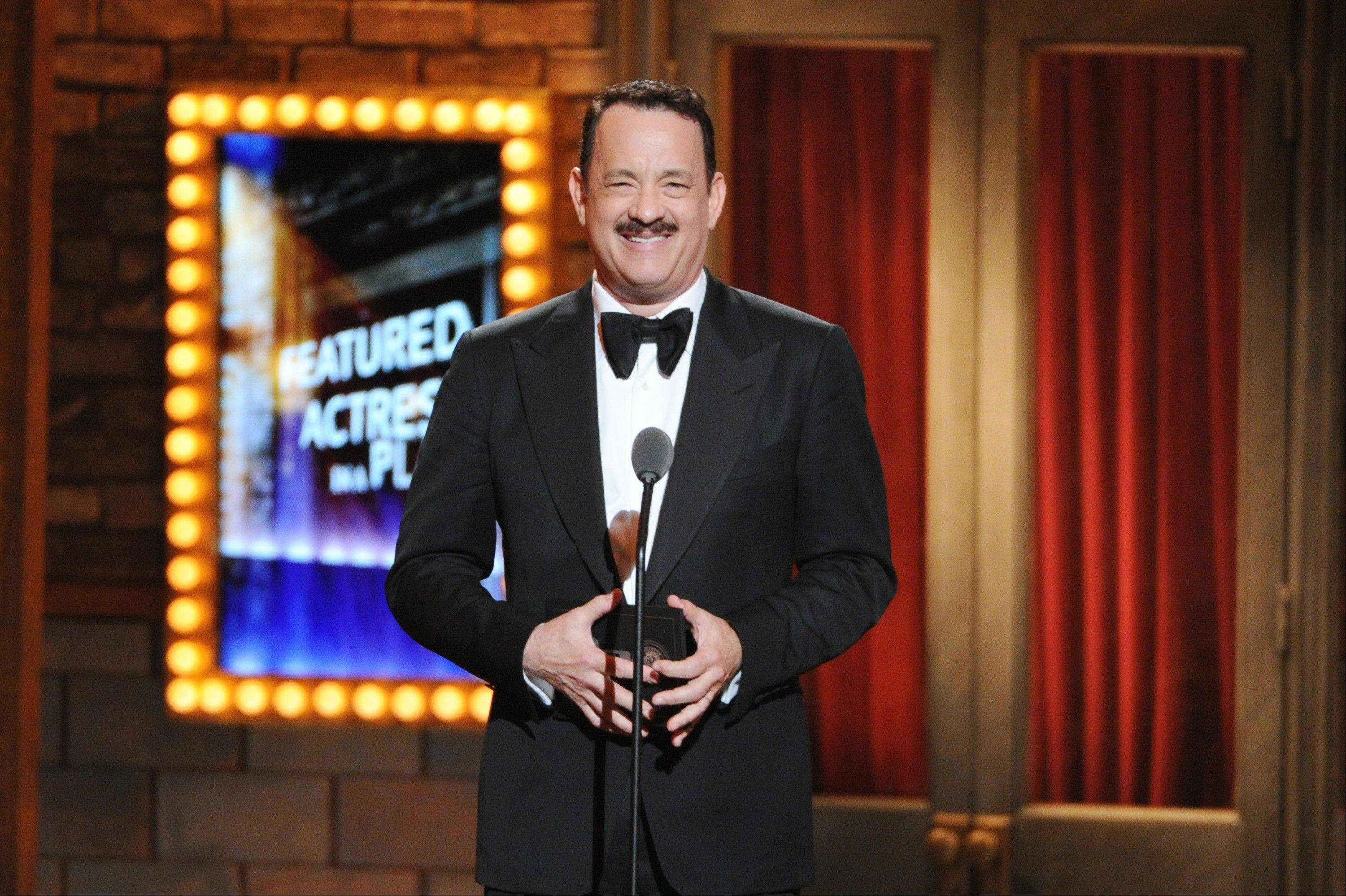 """Lucky Guy"" actor Tom Hanks presents the Best Performance by an Actress in a Featured Role in a Play award at the 67th Annual Tony Awards, on Sunday, June 9, 2013 in New York."