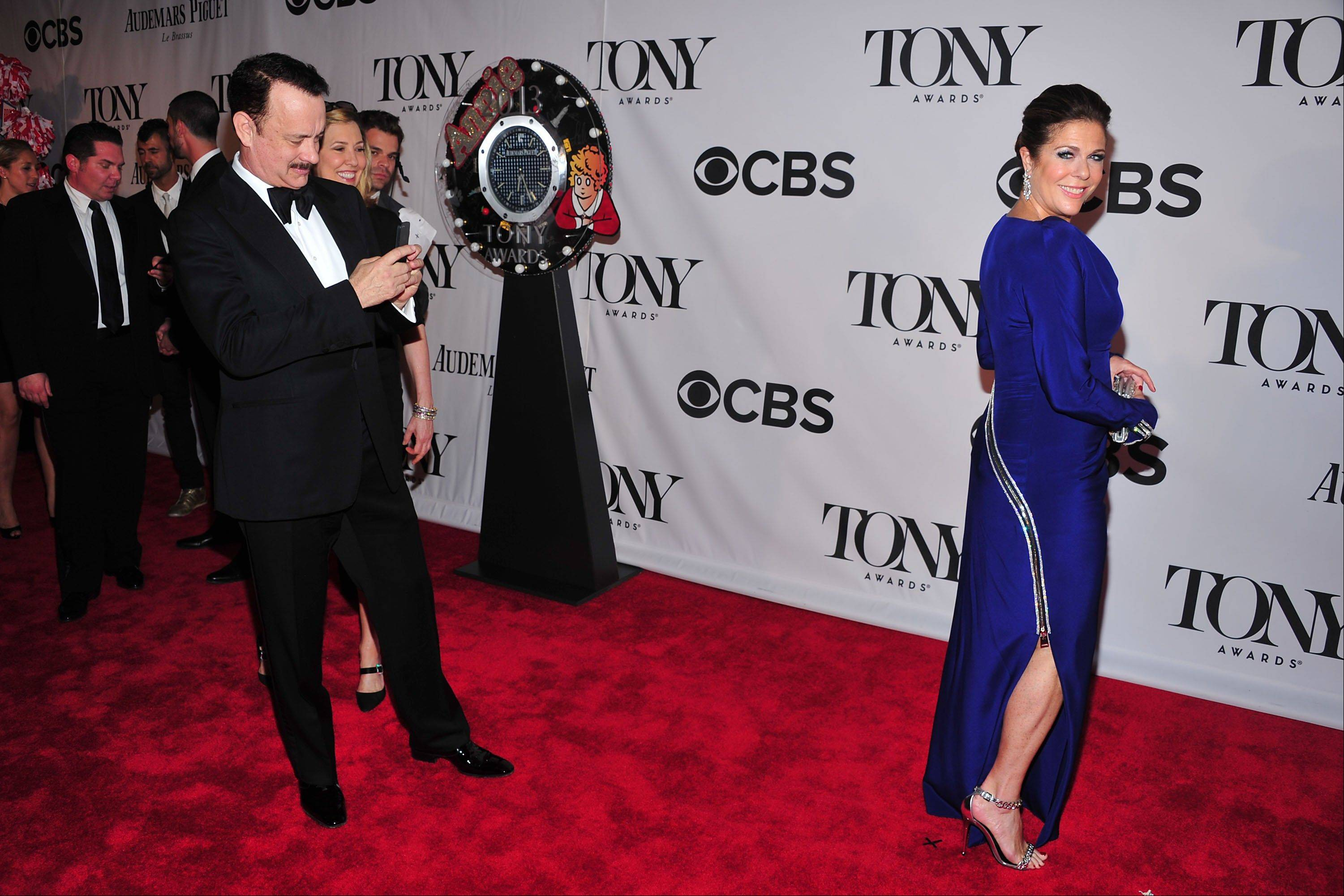 Tom Hanks and Rita Wilson arrives on the red carpet at the 67th Annual Tony Awards, on Sunday, June 9, 2013 in New York.