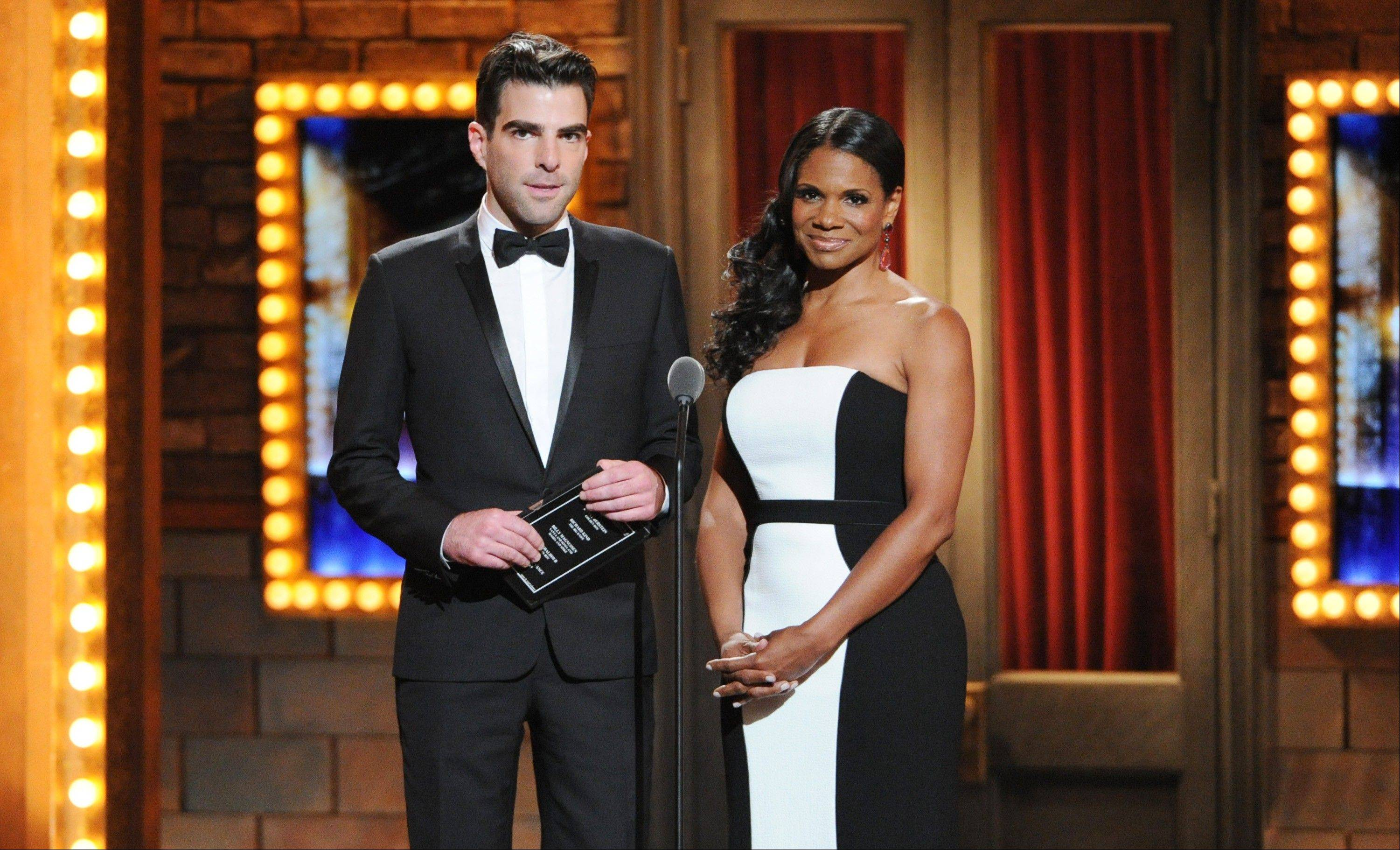 Actor Zachary Quinto, left, and actress, Audra McDonald present the Best Performance by an actor in a featured role in a play award at the 67th Annual Tony Awards, on Sunday, June 9, 2013 in New York.