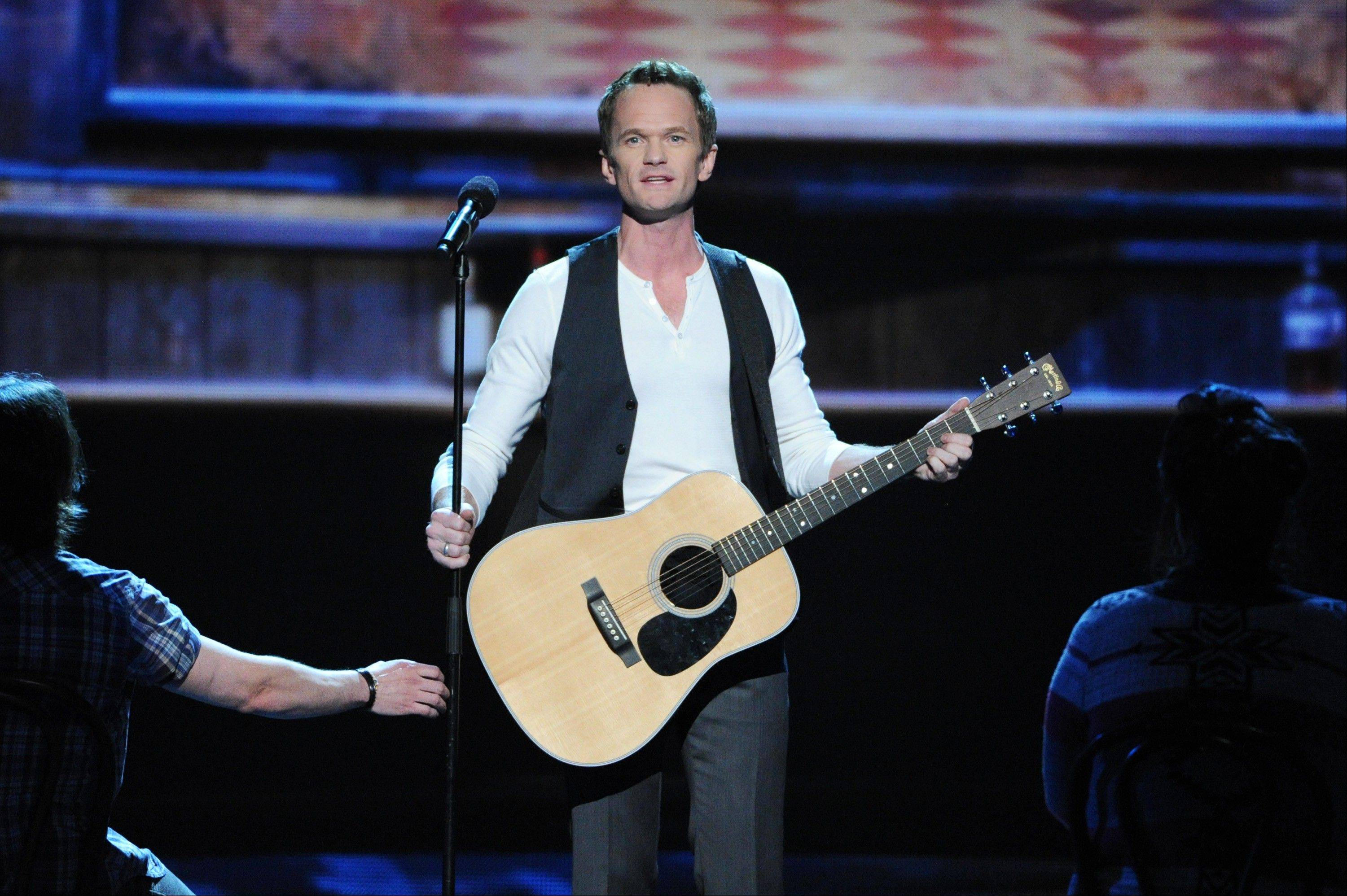 Actor Neil Patrick Harris performs on stage at the opening of the 67th Annual Tony Awards, on Sunday, June 9, 2013 in New York.