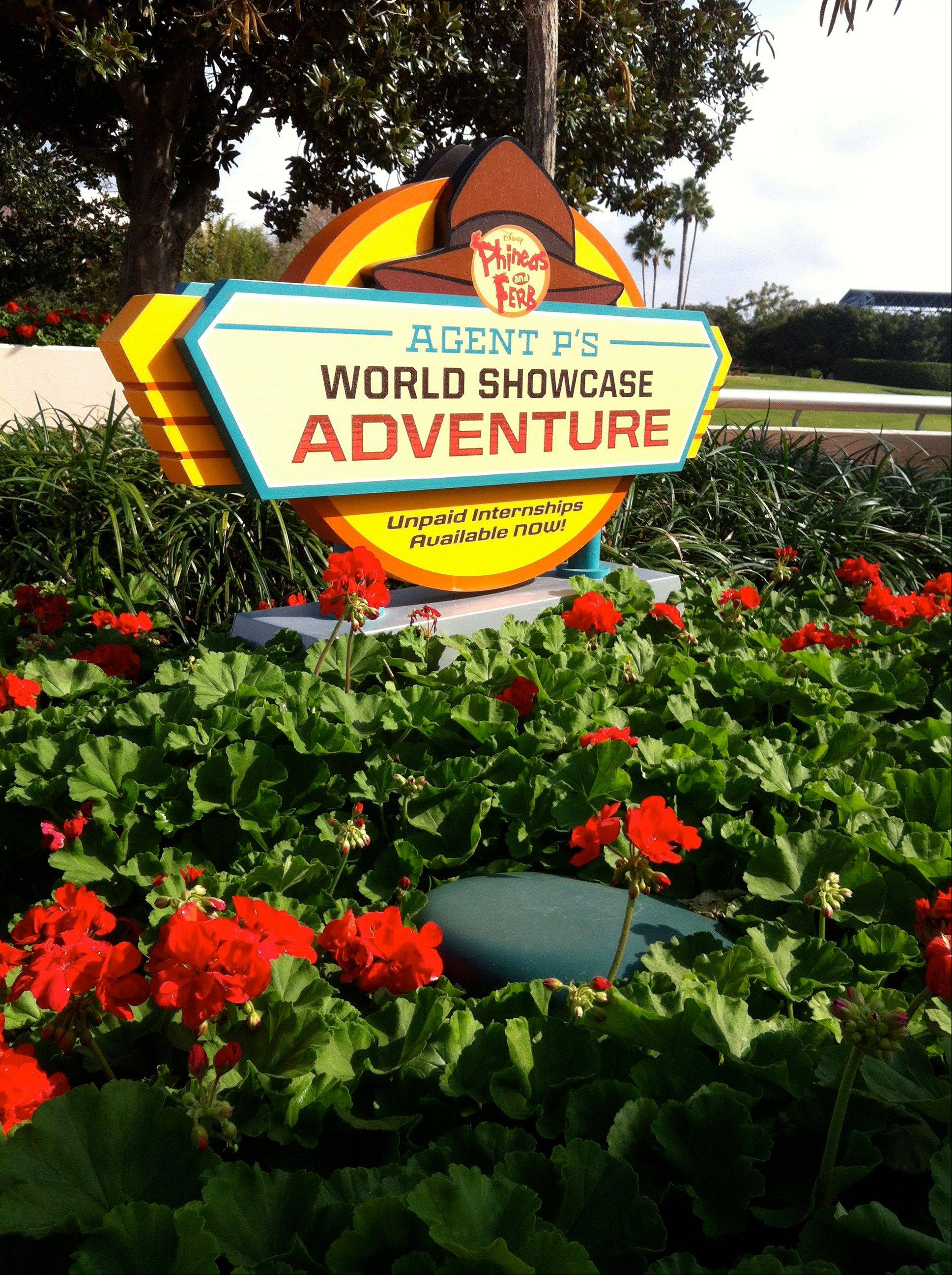 "A sign encourages Walt Disney World guests to participate in the ""Agent P's World Showcase Adventure"" game at the Epcot theme park. The ""Agent P"" game and others like it represent a recent push by Disney World to provide its guests with attractions that allow them to interact with their favorite characters."