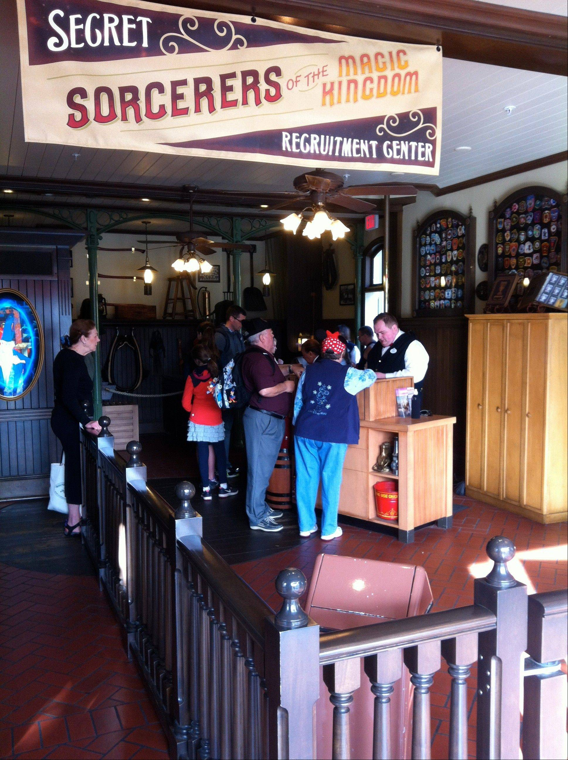 "Prospective participants line up to play the ""Sorcerers of the Magic Kingdom"" game at Walt Disney World's Magic Kingdom theme park in Lake Buena Vista, Fla."