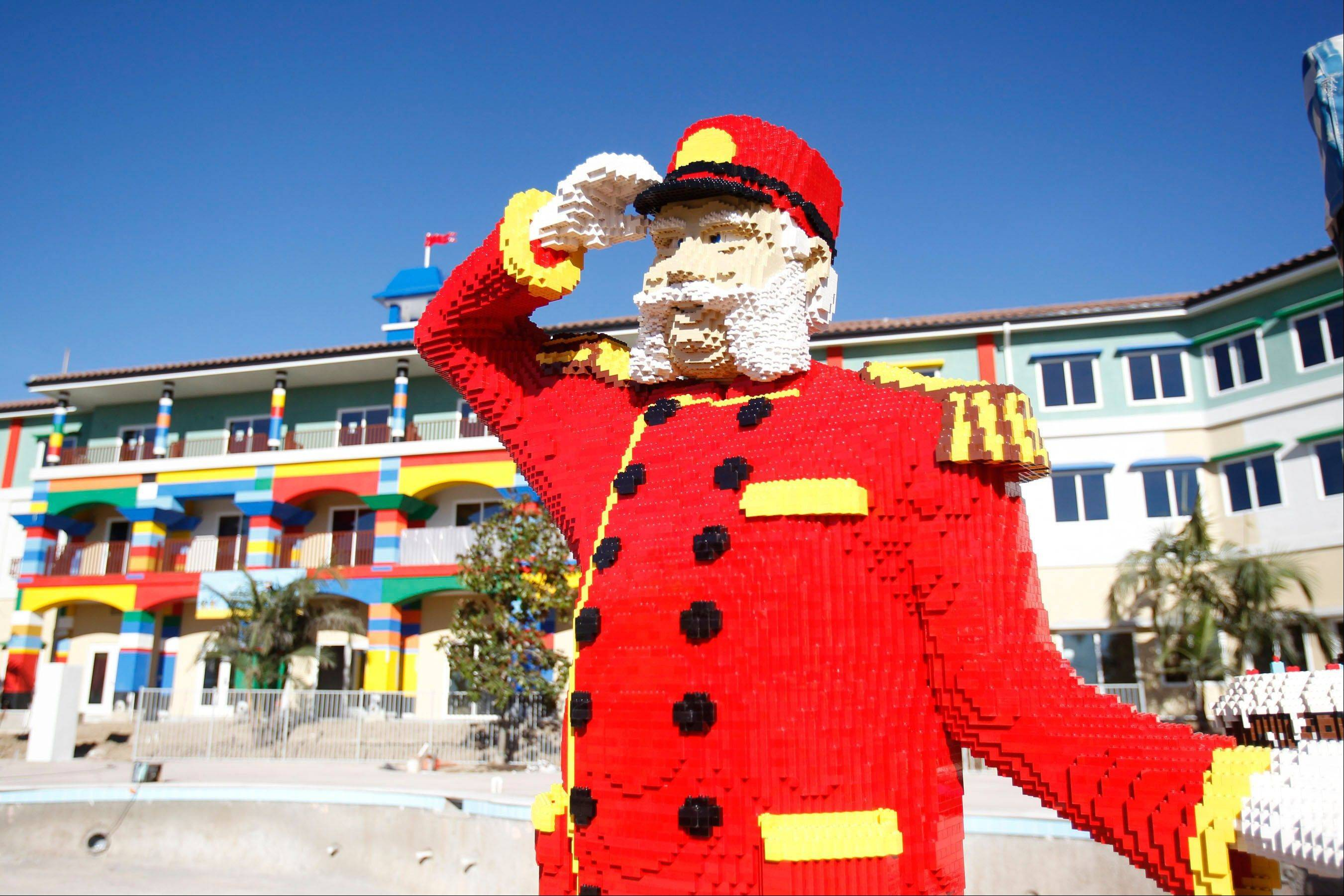 A Bellhop made of Legos greets guests in front of the Legoland Hotel at Legoland California Resort in Carlsbad, Calif.