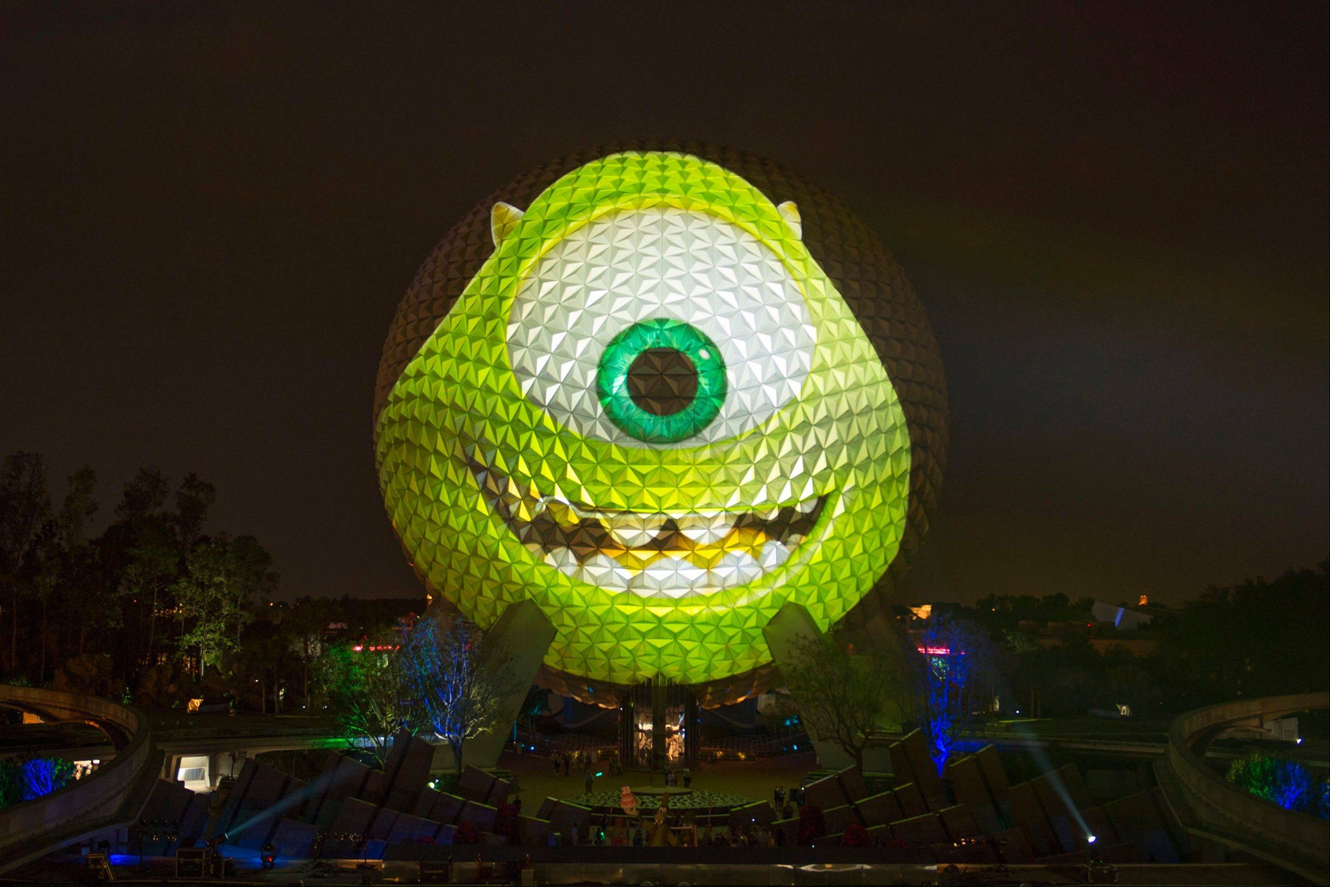 "The image of Mike Wazowski, a character from the upcoming Disney-Pixar animated film ""Monsters University,"" is projected on the exterior of the Spaceship Earth attraction at Epcot in Lake Buena Vista, Fla."