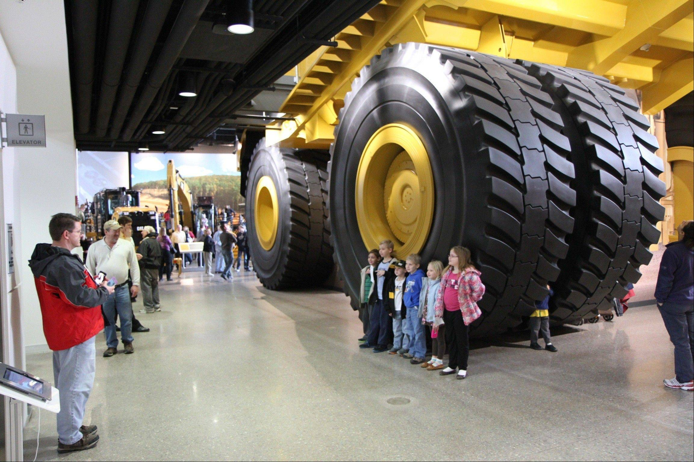 Equipment on display at the Caterpillar Visitors Center in Peoria. Caterpillar Inc. manufactures heavy equipment that bulldozes, digs, lifts and performs other tasks at construction and mining sites.